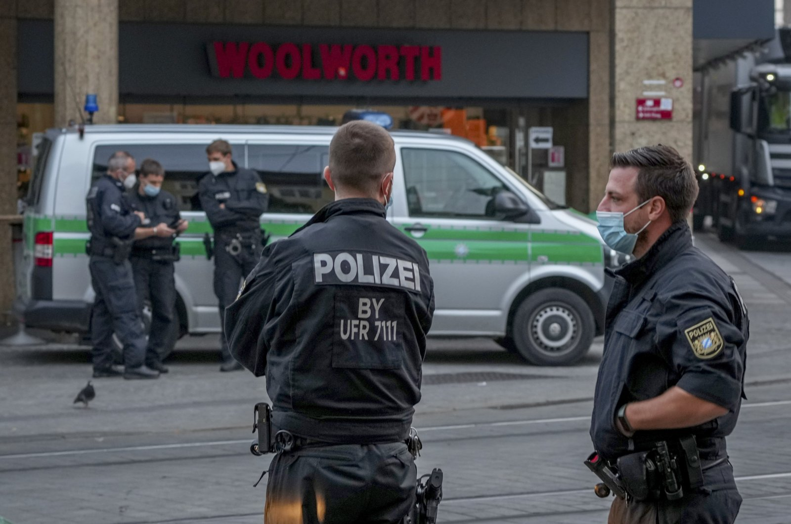 Police officers secure a crime scene in central Wuerzburg, Germany, Saturday, June 26, 2021. (AP Photo)