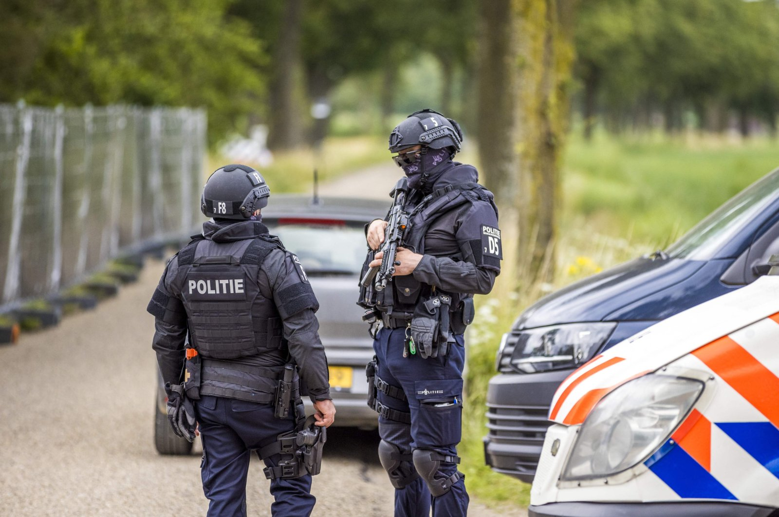 Policemen stand guard at the Hoogbosweg in Nederweert, as the police 'found the largest and most professional production location of crystal meth ever in the Netherlands' it said, July 30, 2021. (AFP File Photo)