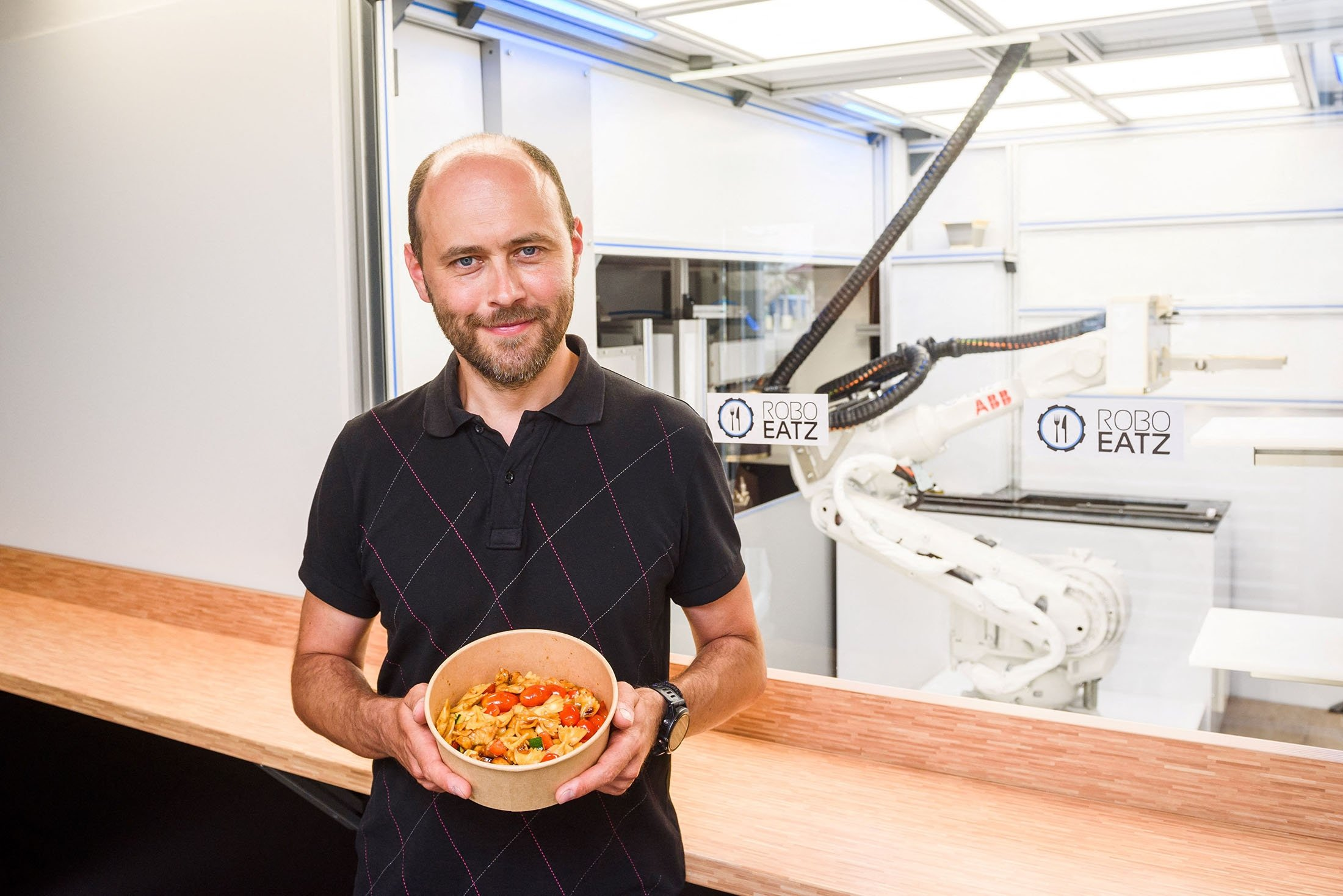 CEO and co-founder of Roboeatz, Konstantins Korcjomkins poses for photos at the Roboeatz eatery in Riga, Latvia, May 25, 2021. (AFP Photo)