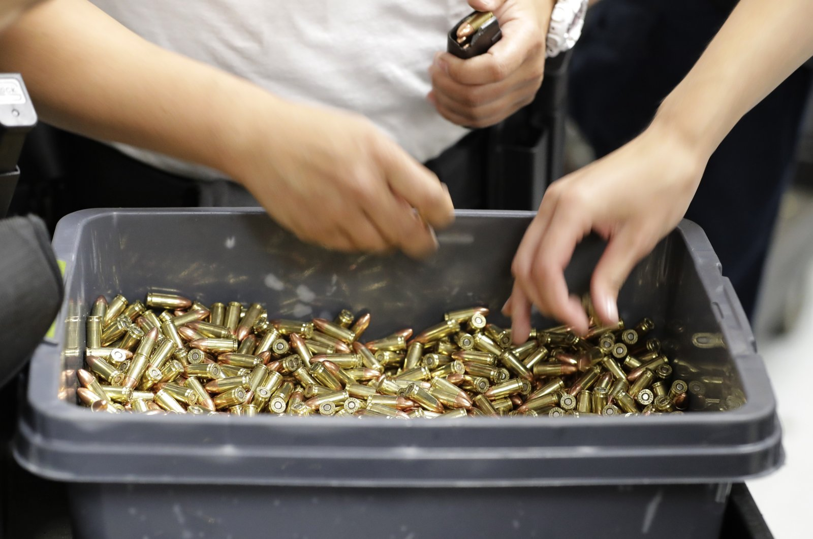 Officers taking part in training load gun clips with ammunition at the Washington State Criminal Justice Training Commission in Burien, Washington, U.S., July 16, 2019. (AP Photo)