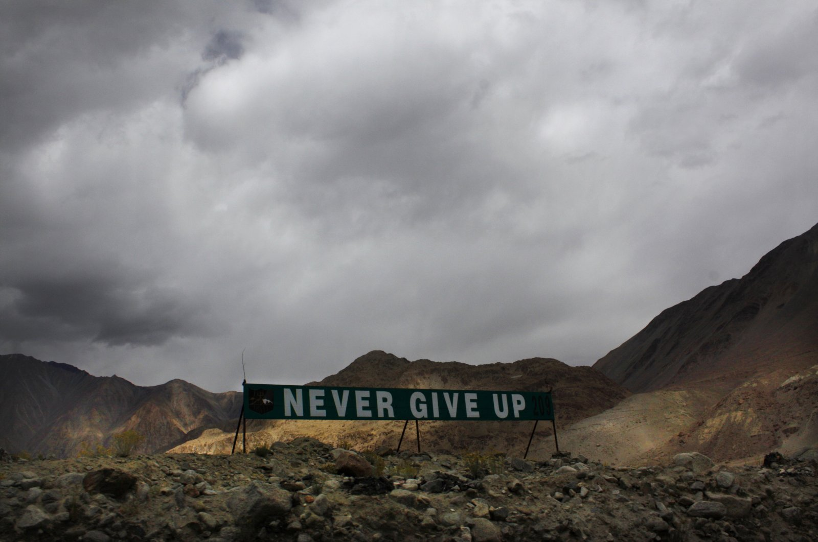 A banner erected by the Indian army stands near Pangong Tso lake near the India-China border in India's Ladakh area, Sept. 14, 2017. (AP Photo)