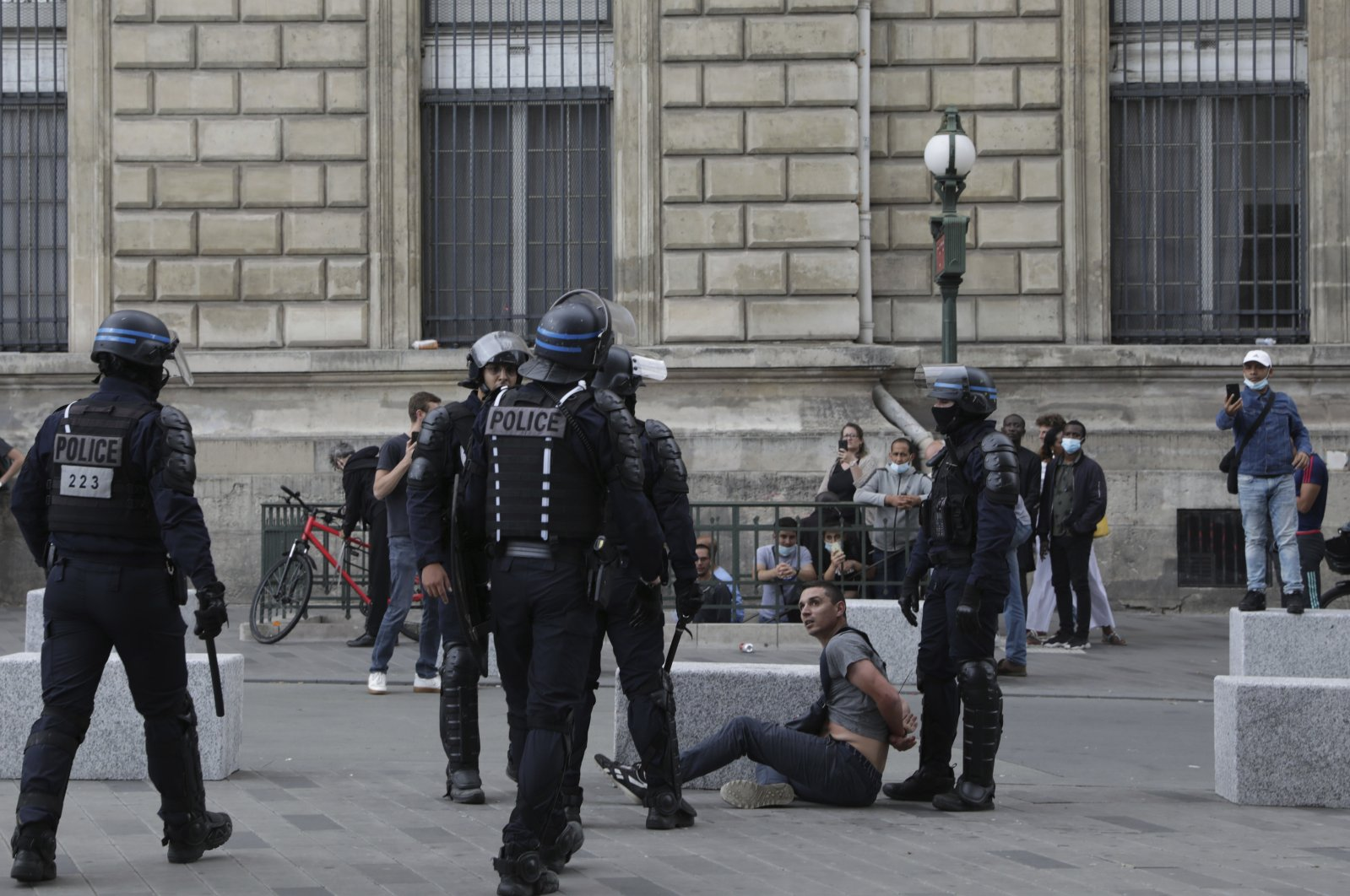 Police detain a protestor during a demonstration in Paris, France, July 31, 2021. (AP Photo)