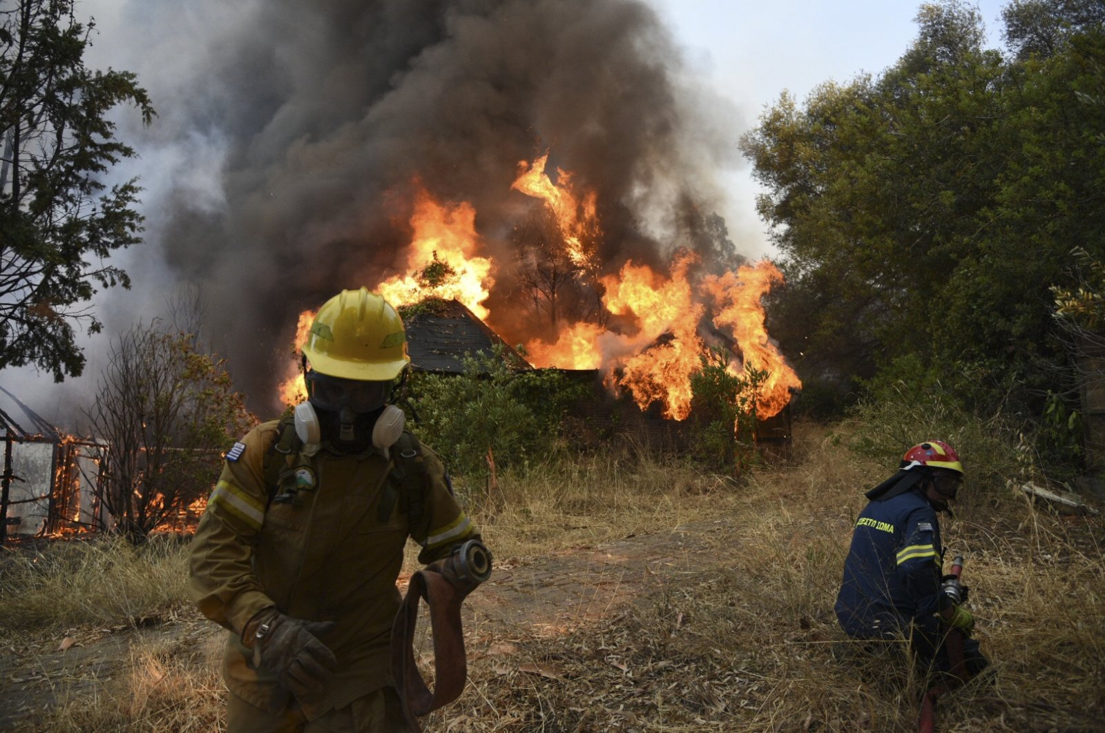 Firefighters operate during a wildfire near Lampiri village, west of Patras, Greece, July 31, 2021. (AP Photo)