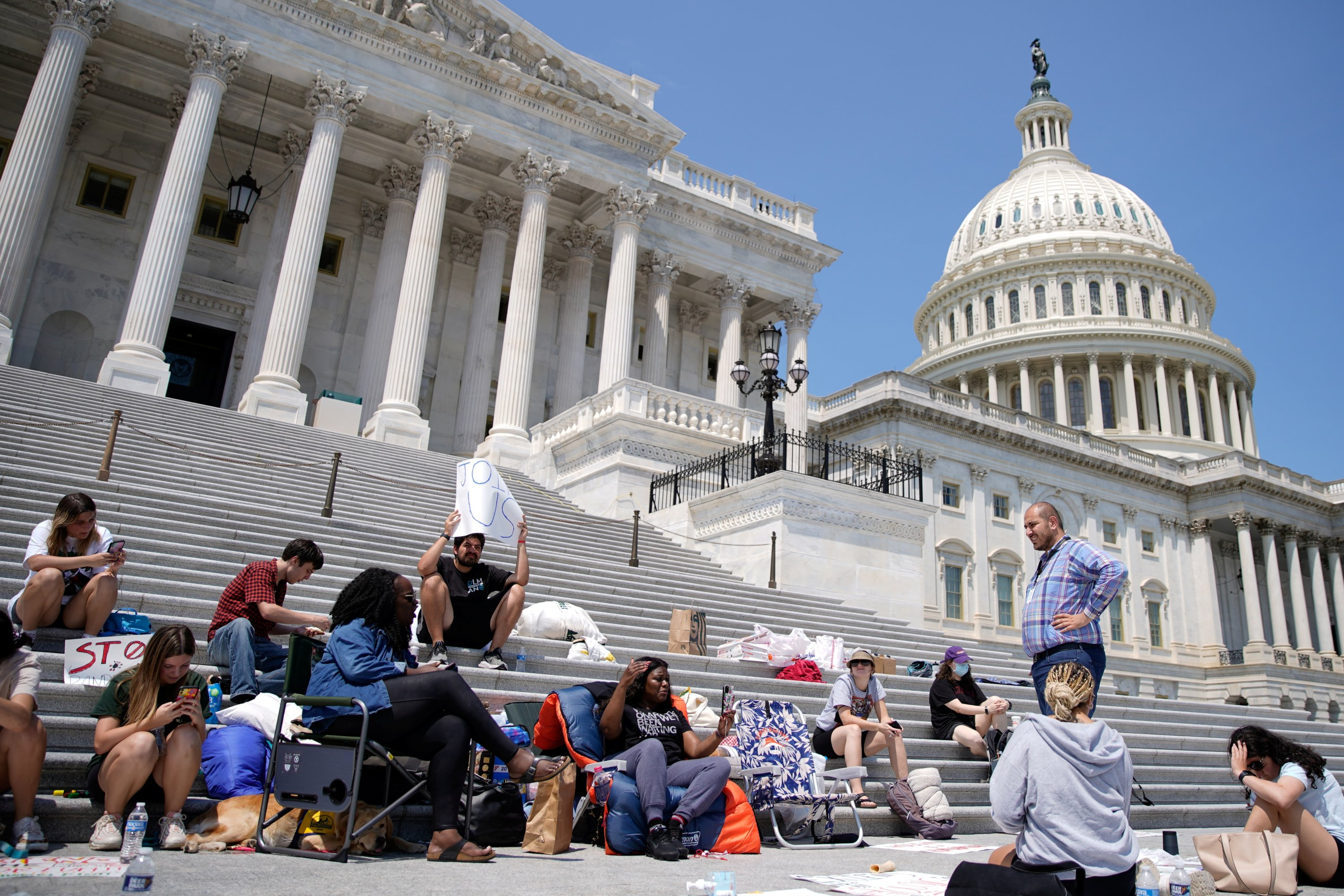 People camp out on the steps of the U.S. Capitol to highlight the upcoming expiration of the pandemic-related federal moratorium on residential evictions, in Washington, U.S., July 31, 2021. (Reuters Photo)