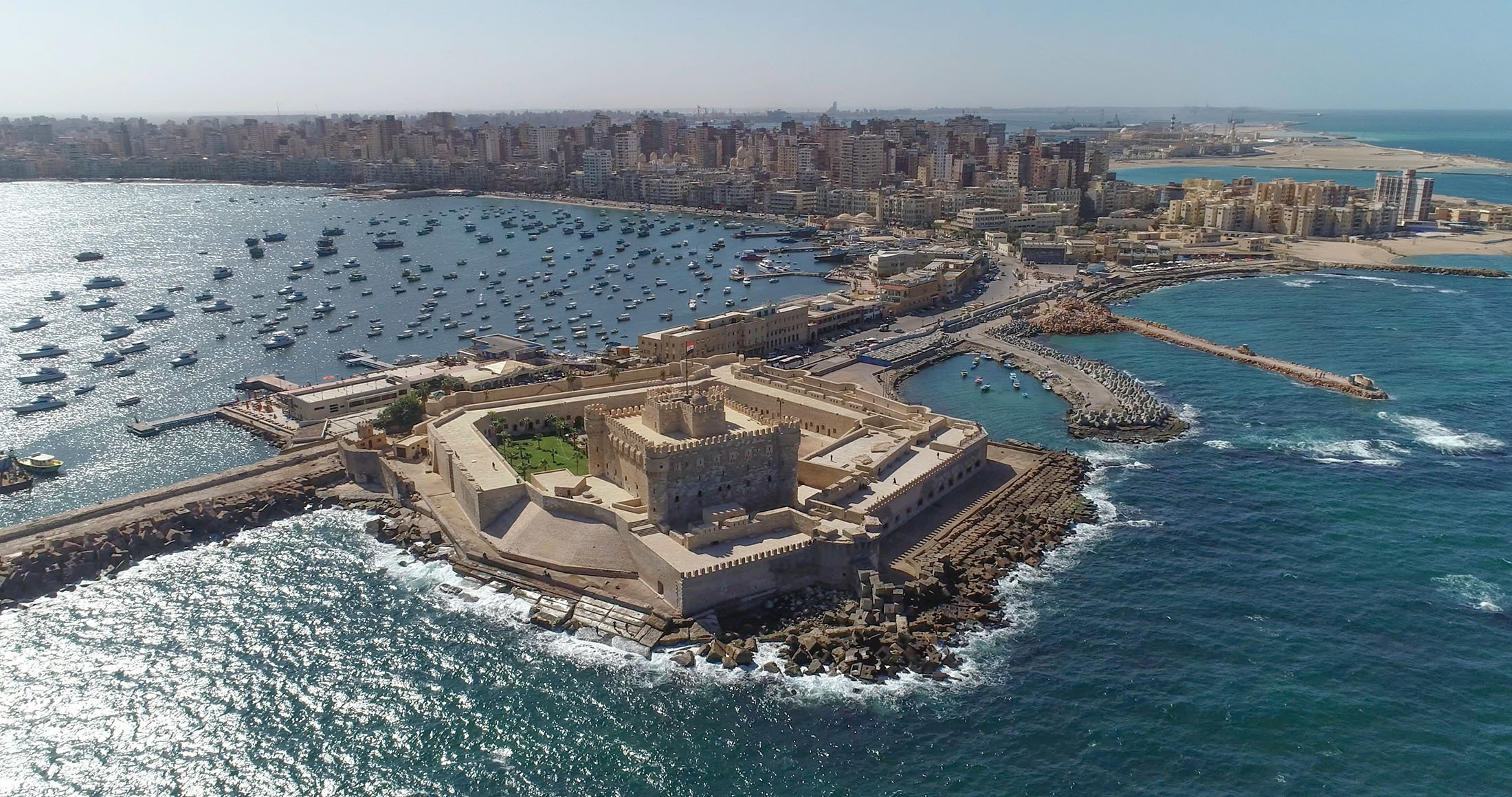 An aerial view shows the city of Alexandria with theCitadel of Qaitbay shining in the sun, Alexandria, Egypt. (Shutterstock Photo)