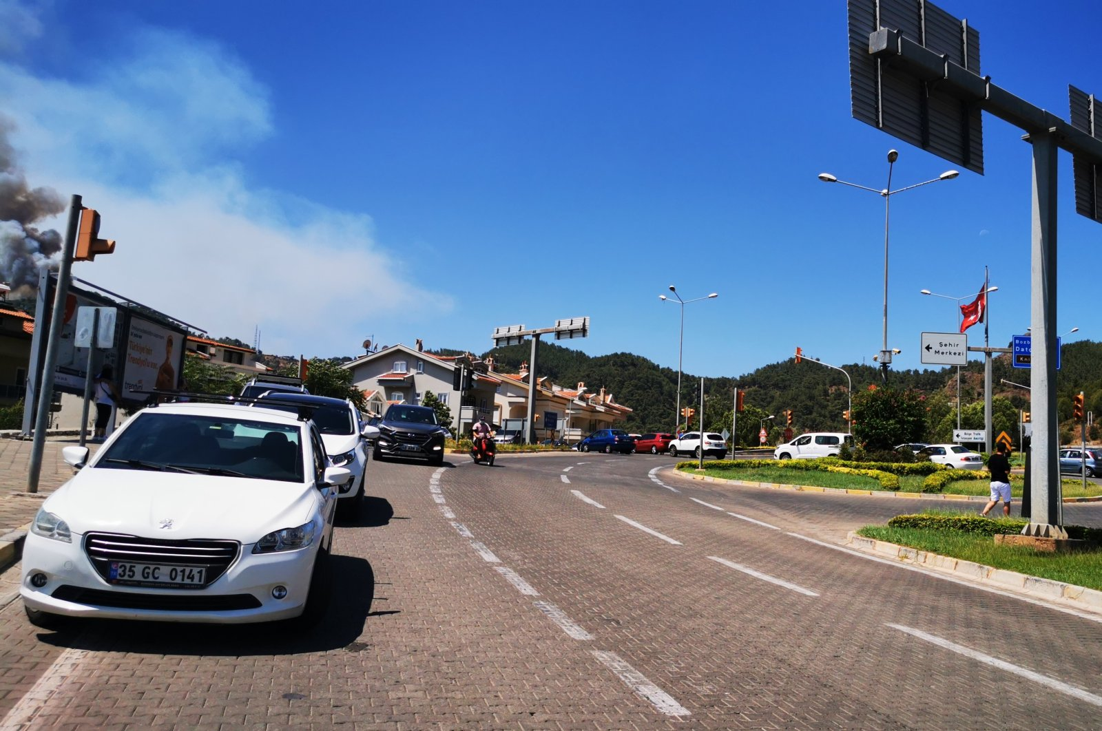 The road connecting Datça and Marmaris districts is seen closed due to forest fires on July 31, 2021 (IHA Photo)