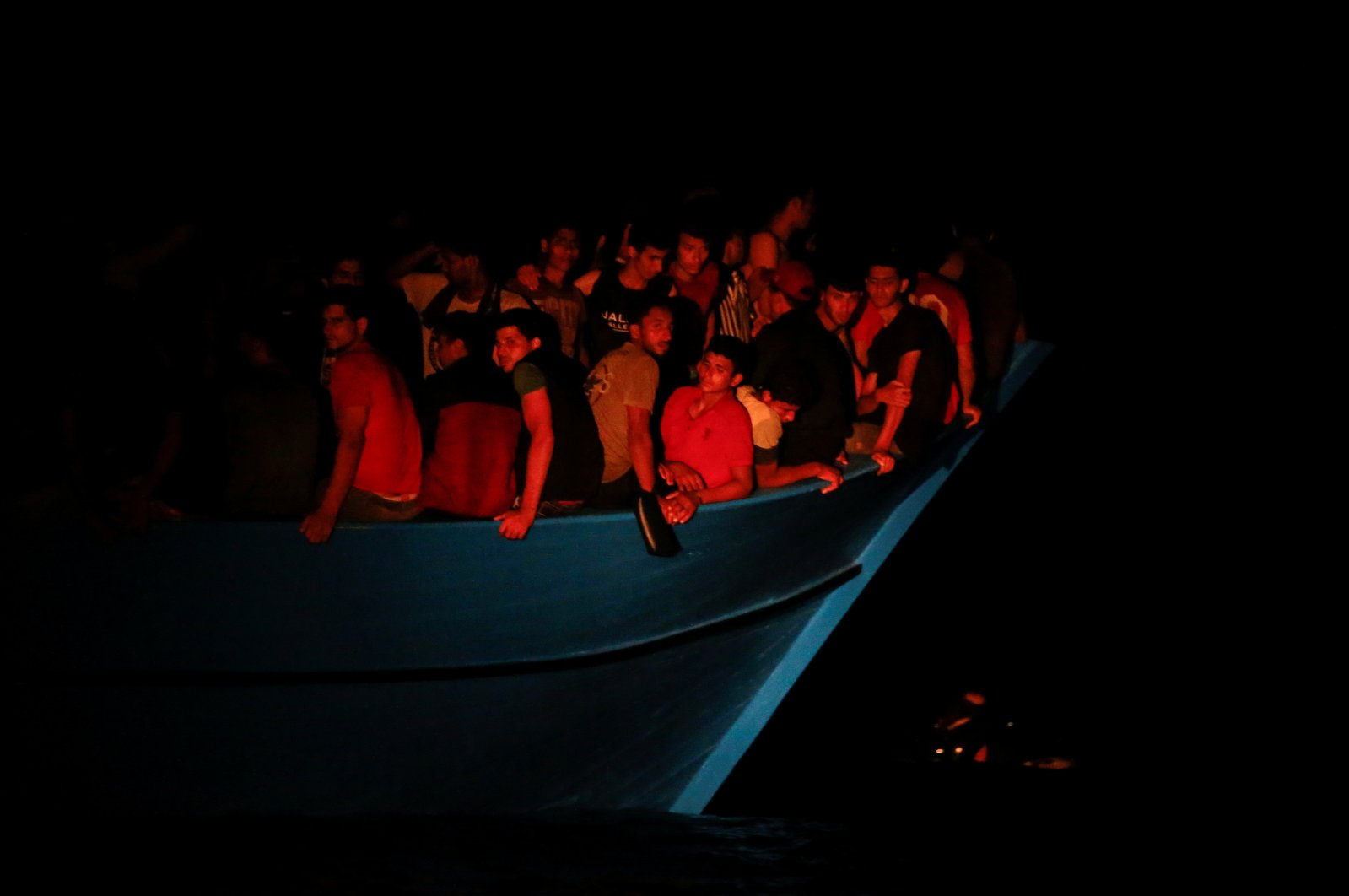 Migrants on an overcrowded wooden boat await rescue by the German NGO migrant rescue ship Sea-Watch 3 and the French NGO SOS Mediterranee ship Ocean Viking, during a rescue operation in international waters off the coast of Tunisia, the western Mediterranean Sea, July 31, 2021. (Reuters Photo)