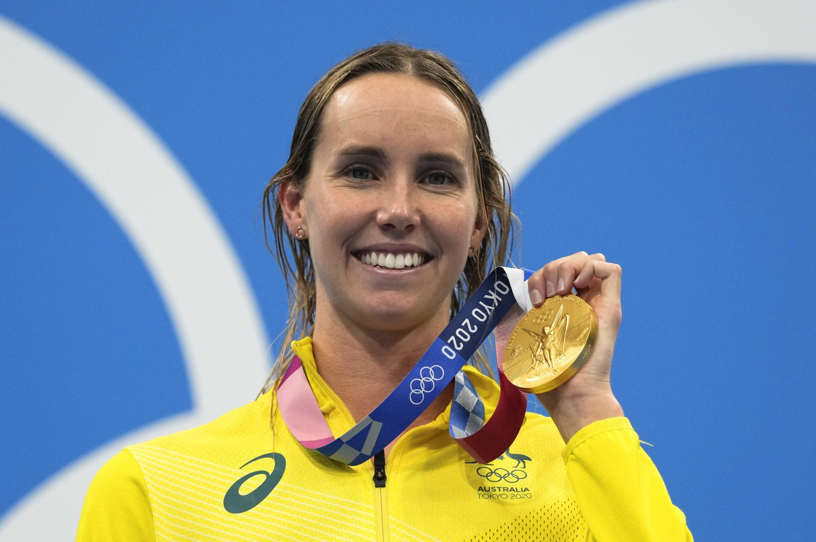 Australia's Emma Mckeon poses with the gold medal in the women's 50-meter freestyle final at the 2020 Summer Olympics, Tokyo, Japan, Aug. 1, 2021. (AP Photo)