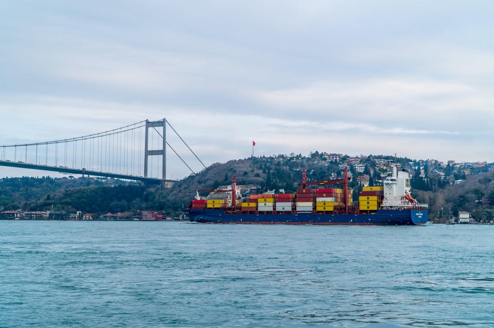 A container ship sails through the Bosporus passing under the Fatih Sultan Mehmet Bridge in Istanbul, Turkey, Feb. 19, 2021. (Shutterstock Photo)