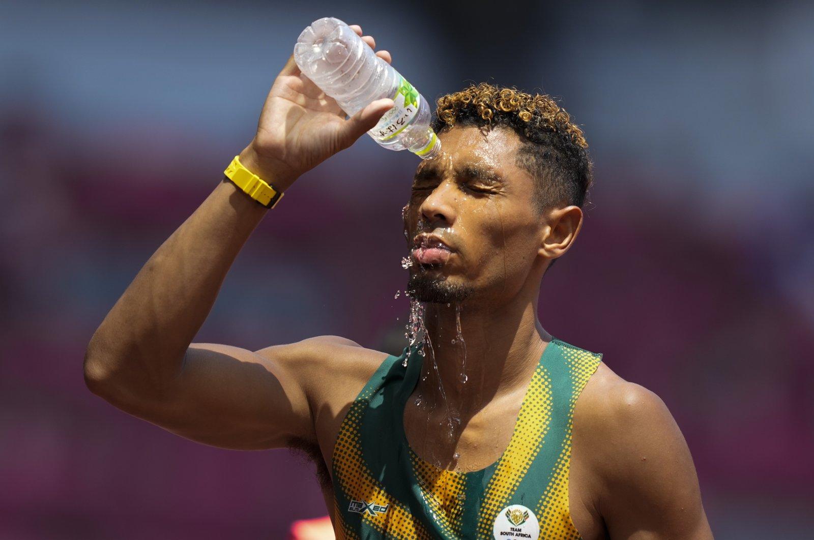 South Africa's Wayde Van Niekerk cools off after a heat in the men's 400-meter run at the 2020 Summer Olympics, Tokyo, Japan, Aug. 1, 2021. (AP Photo)