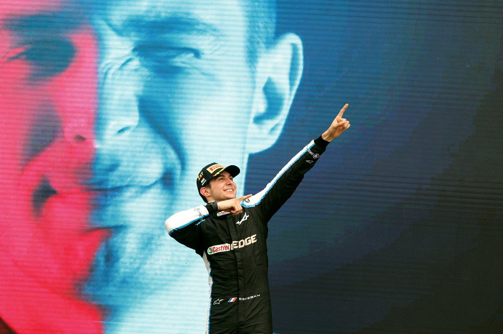 Alpine's Esteban Ocon celebrates on the podium after winning the race, Aug. 1, 2021. (Reuters Photo)