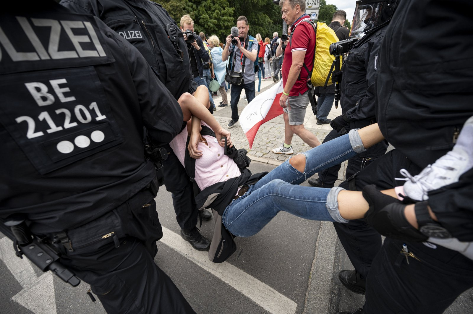Police arrest a demonstrator at an unannounced demonstration against COVID-19 restrictions at the Victory Column, in Berlin,  Germany, Aug. 1, 2021. (dpa via AP)