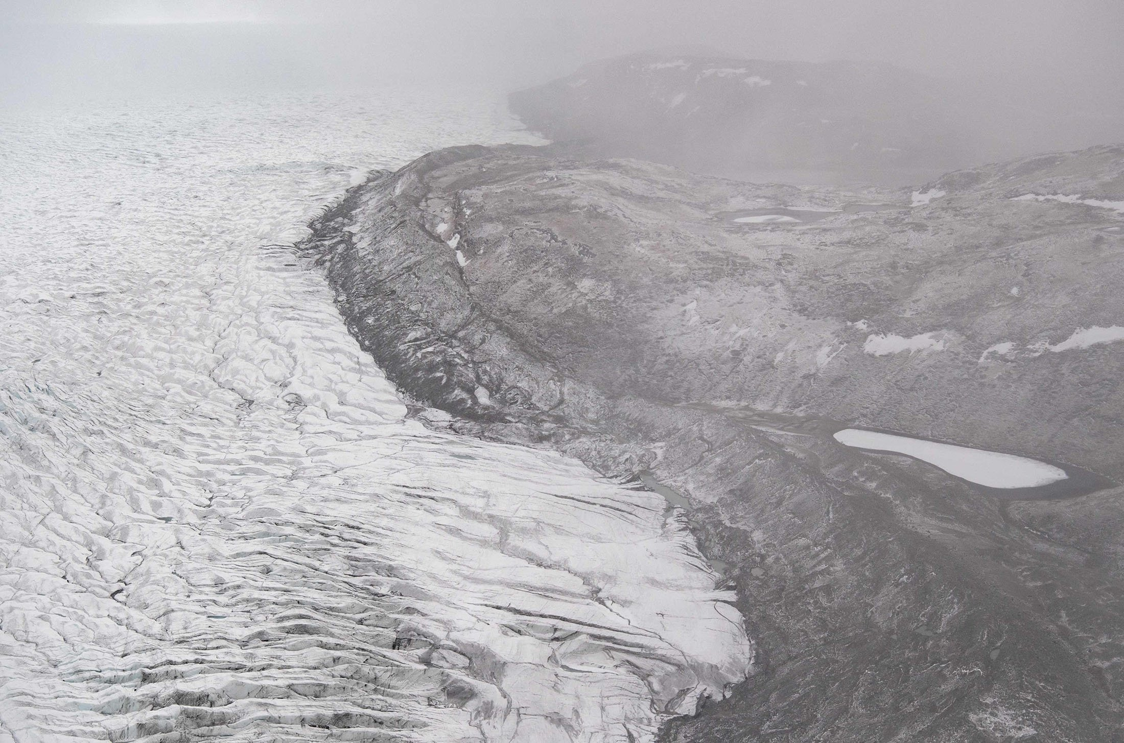 Ice recedes from a glaciernear Kangerlussuaq, Greenland, May 20, 2021. (AFP Photo)