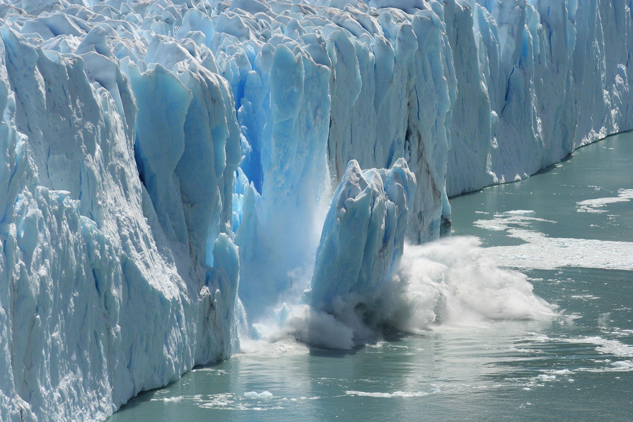 A massive block of ice breaks off a glacier in Antarctica. (Shutterstock Photo)