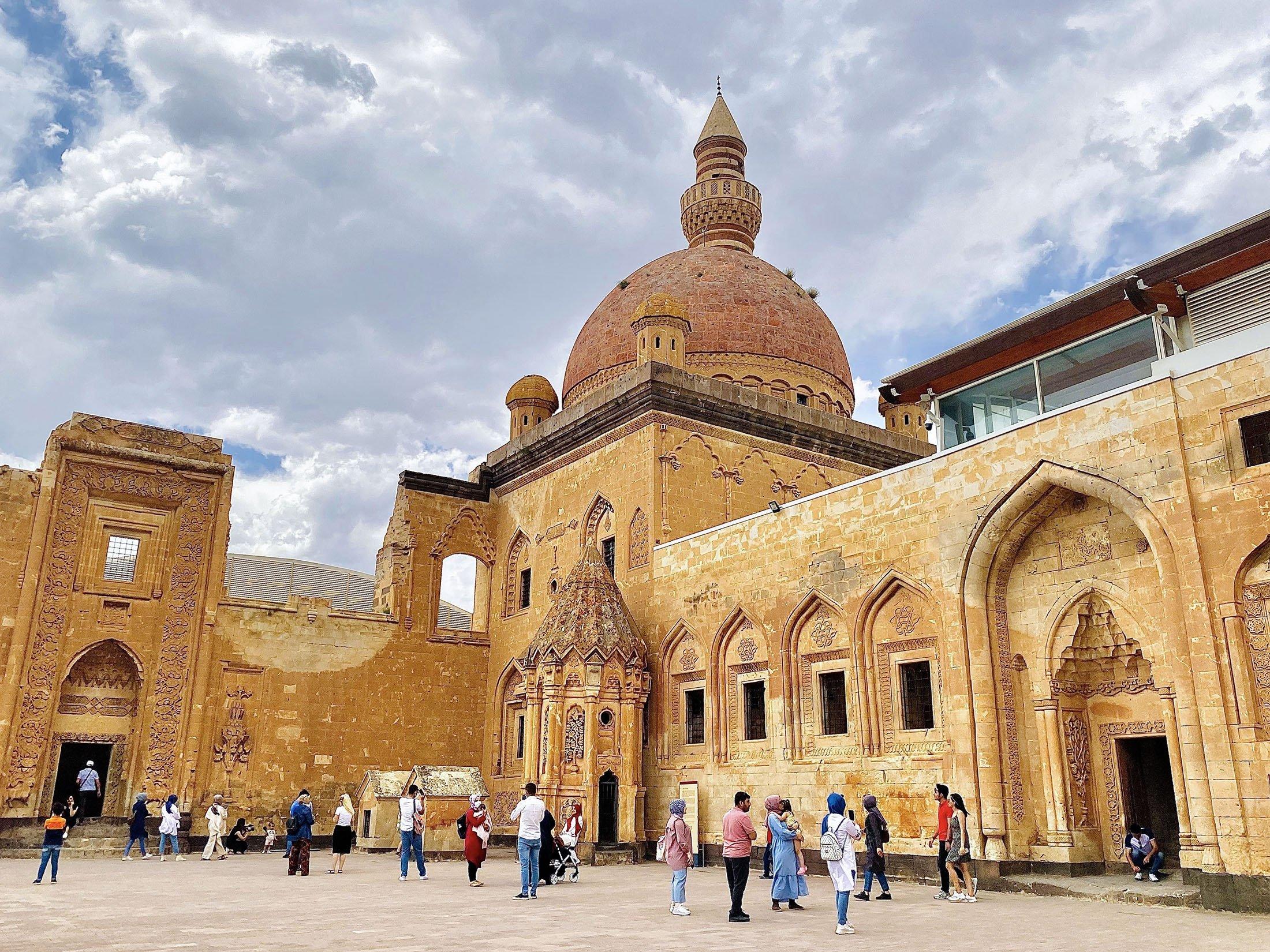 People wander in the courtyard of the Ishak Pasha Palace can be seen from afar inthe Doğubayazıt district of Ağrı, Turkey, July 30, 2021. (IHA Photo)