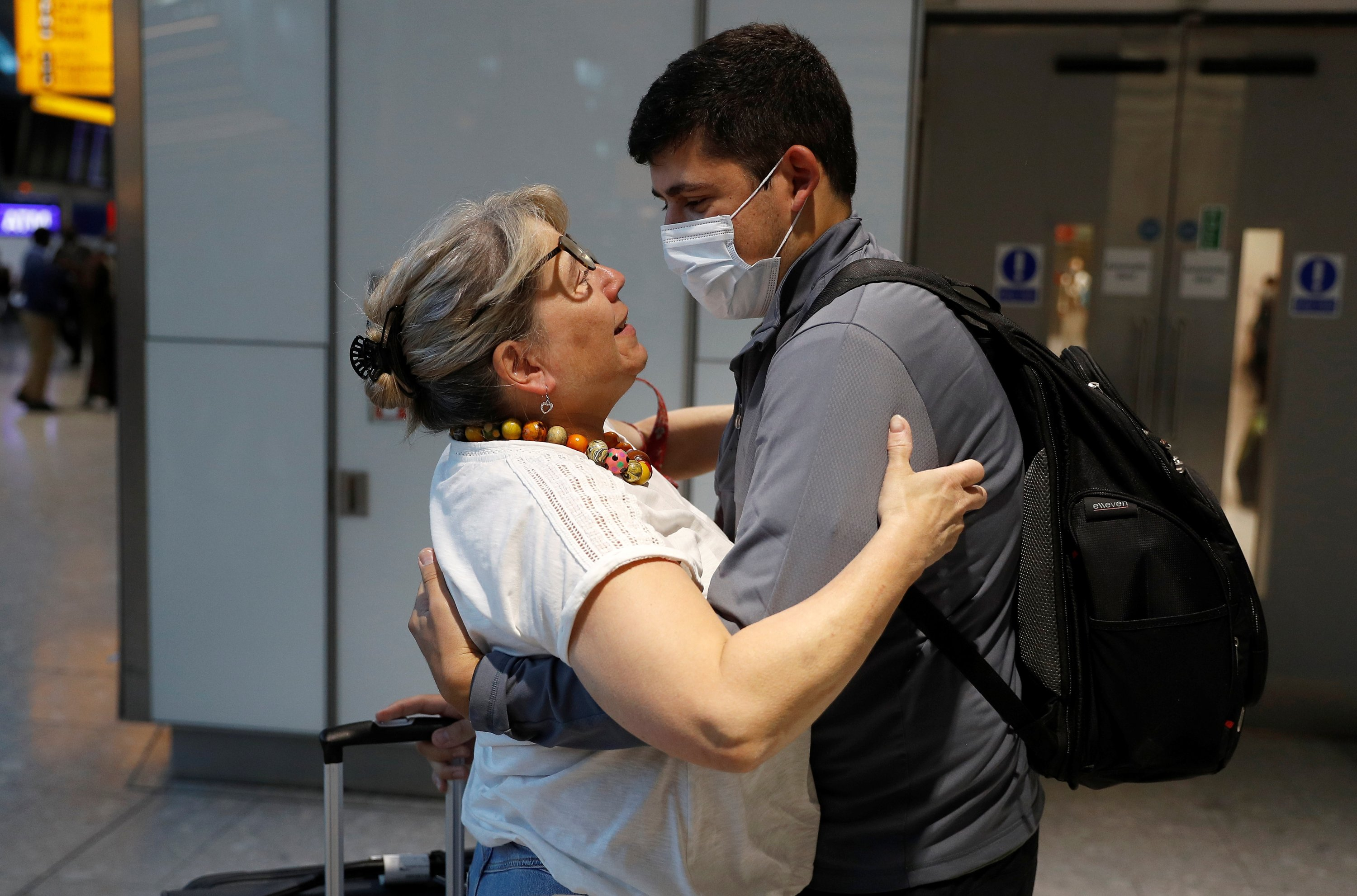 Karen Tyler embraces her son Jonathan who arrived from the U.S., at the international arrivals area of Terminal 5 in London's Heathrow Airport, Britain, Aug. 2, 2021. (Reuters Photo)