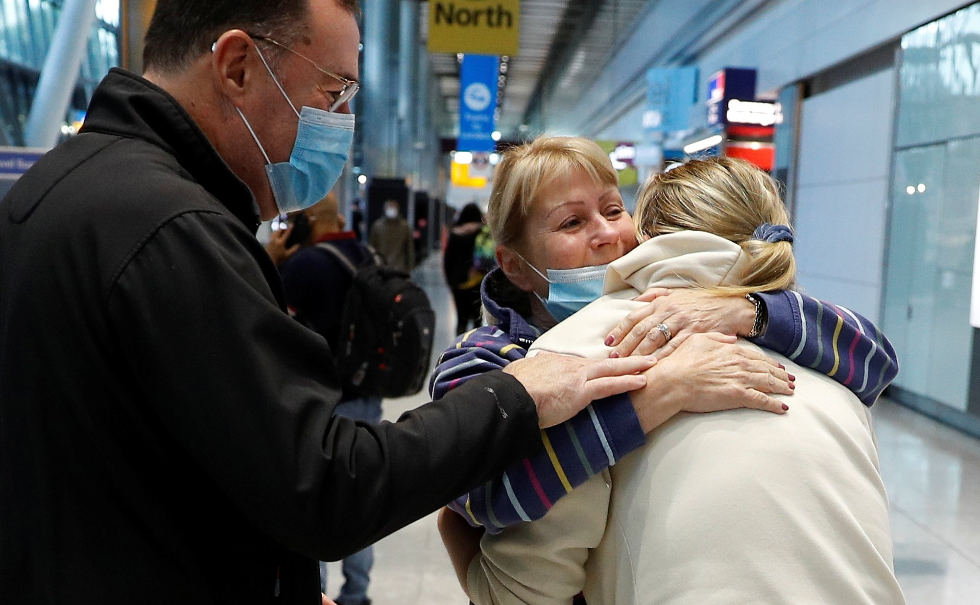 Claire and Steven Frohlich embrace their daughter who returned from the U.S., in the international arrivals area of Terminal 5 at London's Heathrow Airport, Britain, Aug. 2, 2021. (Reuters Photo)