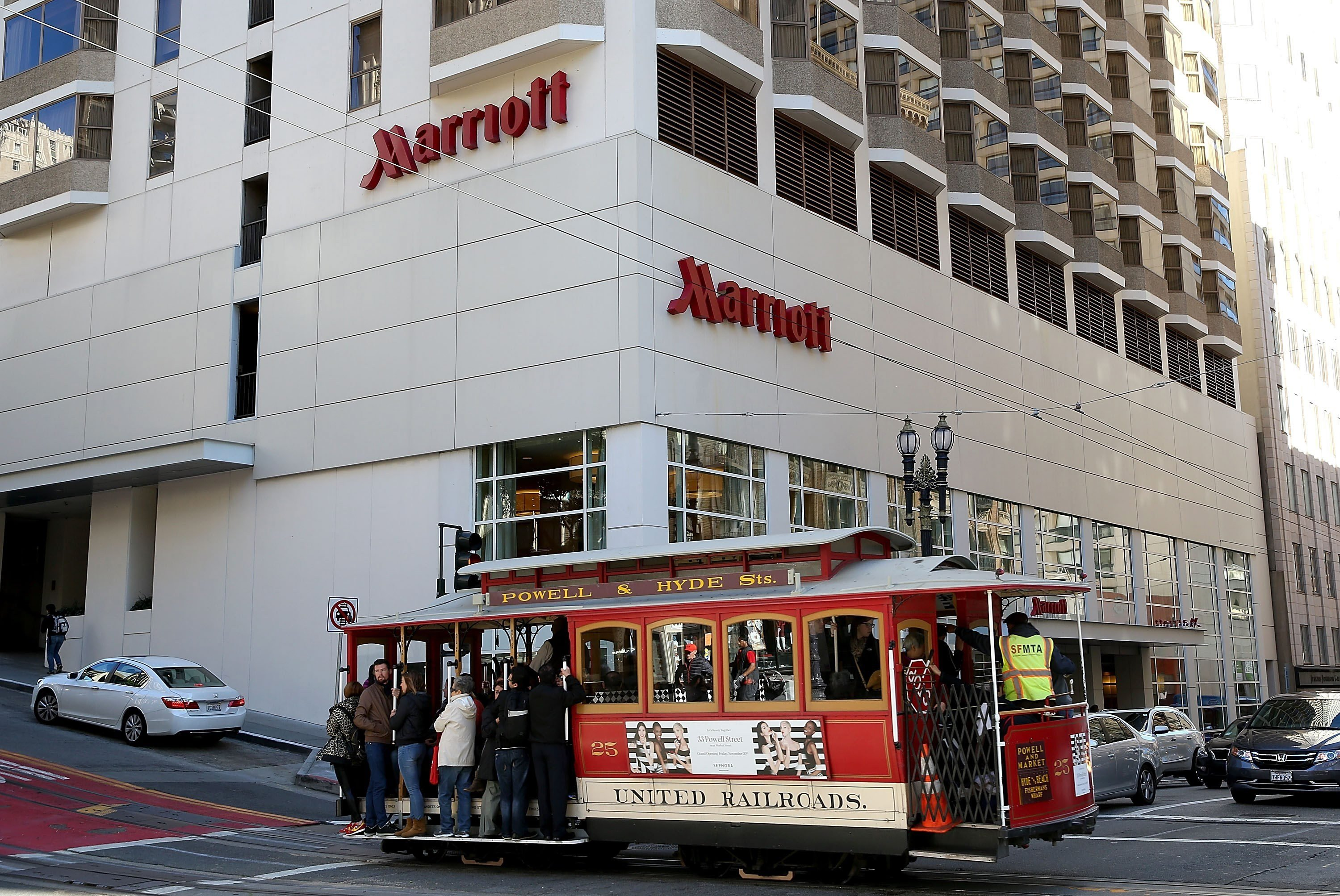 A cable car passes in front of a Marriott hotel in San Francisco, California, U.S., Nov. 16, 2015 (Getty Images via AFP File Photo)