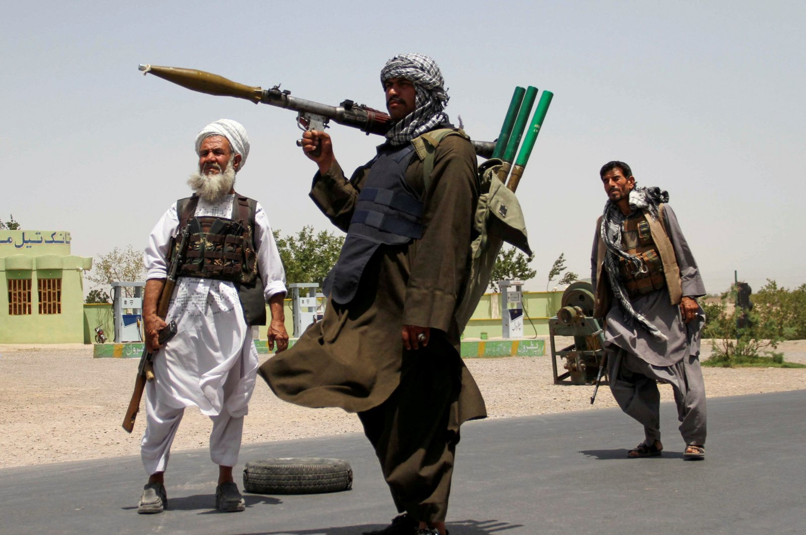 Former Mujahideen hold weapons to support Afghan forces in their fight against the Taliban on the outskirts of Herat province, Afghanistan, July 10, 2021. (Reuters Photo)