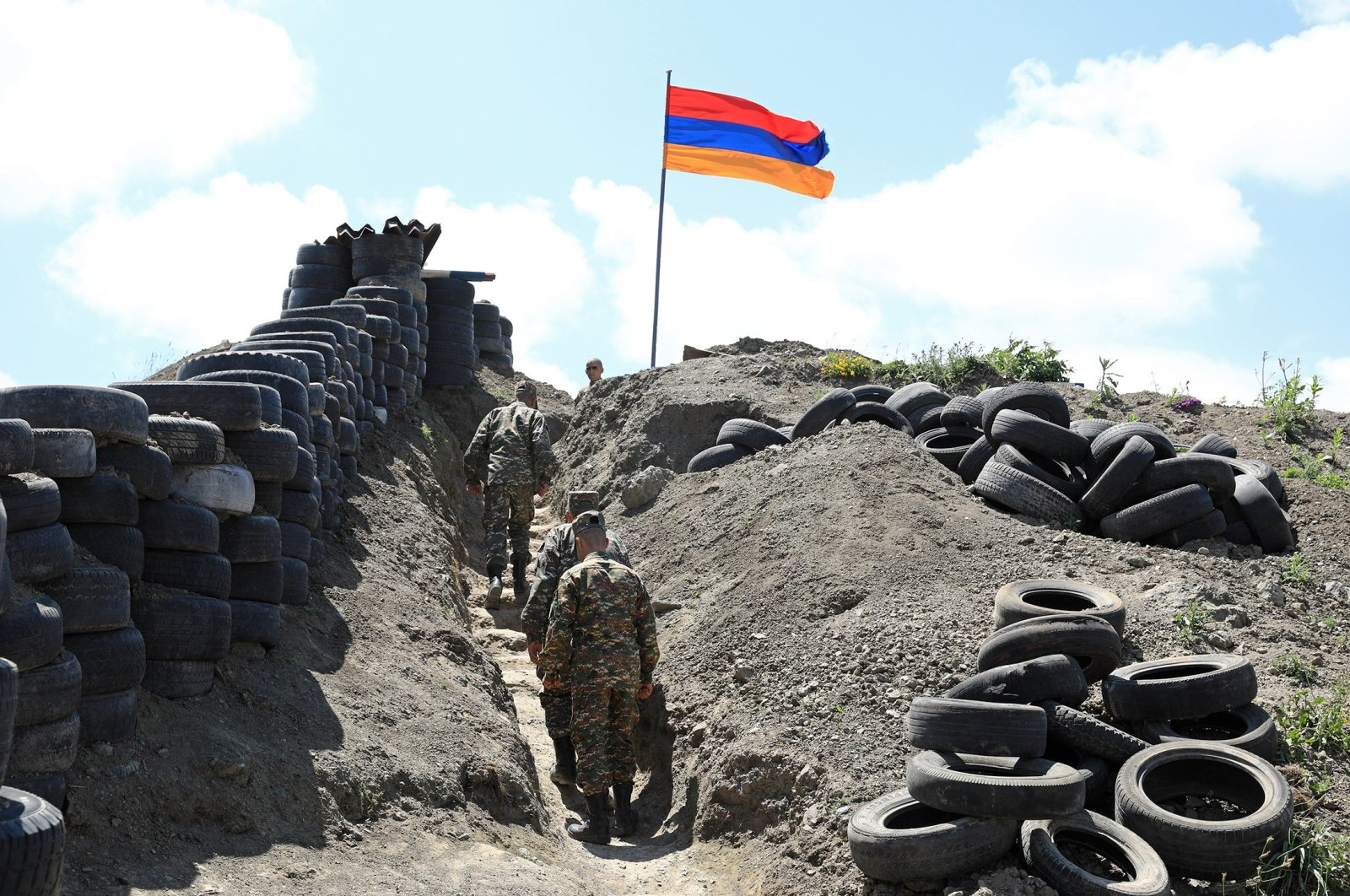 A flag over an observation post at an Armenian checkpoint at the Sotk gold mine on the border with Azerbaijan, June 18, 2021 (Reuters Photo)