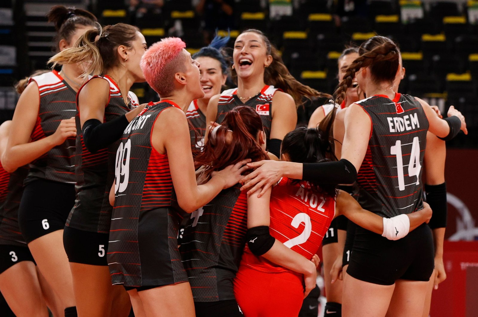 Turkish volleyball players celebrate after winning their Pool B match against theRussian Olympic Committee (ROC)Ariake Arena, Tokyo, Japan, Aug. 2, 2021. (Reuters Photo)