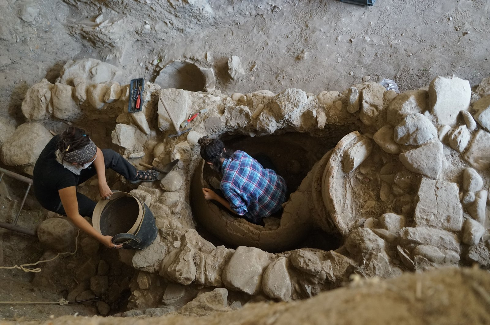 Archaeologists work at the pithos burial in the ancient city of Antandros, Balıkesir, Turkey, July 31, 2021. (AA Photo)