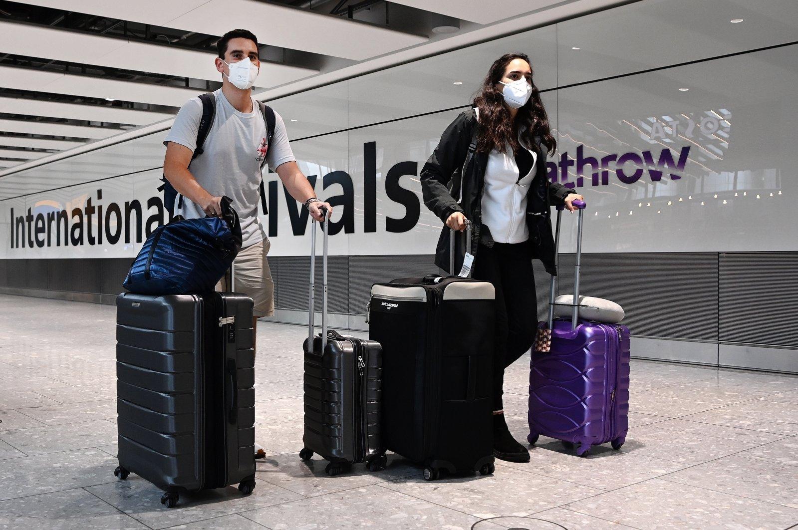 Travelers arrive at Heathrow Airport in London, U.K., July 31, 2021. (EPA Photo)