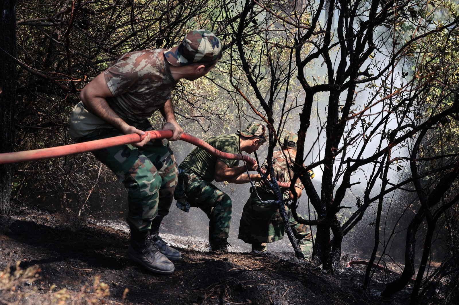 Azerbaijani firefighters help efforts to extinguish a fire in the town of Marmaris, in Muğla, southwestern Turkey, July 31, 2021. (AA PHOTO)
