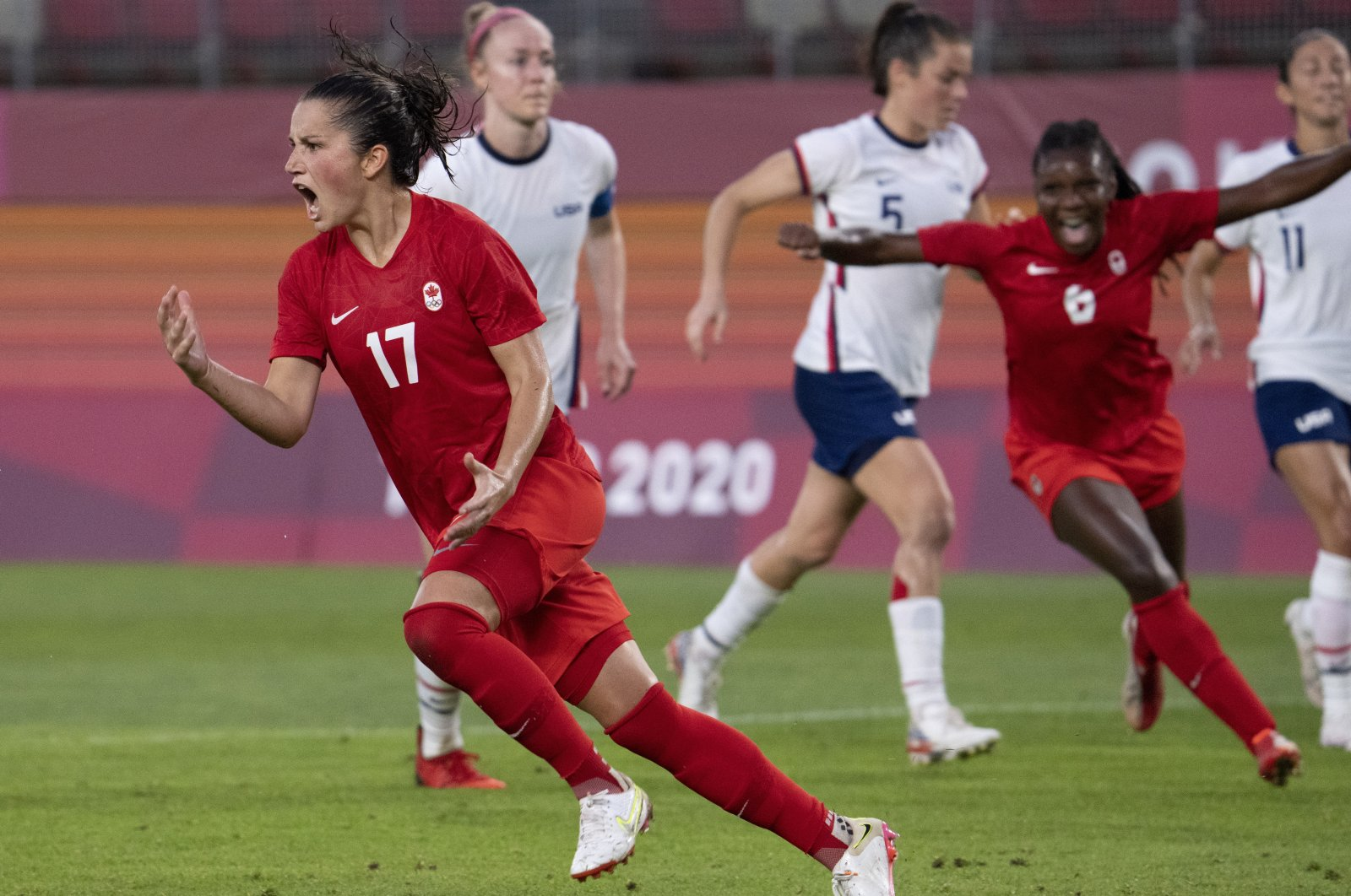 Canada midfielder Jessie Fleming (L) celebrates her game-winning penalty during the women's semifinal match against the USA at the 2020 Summer Olympics, Kashima, Japan, Aug. 2, 2021. (AP Photo)