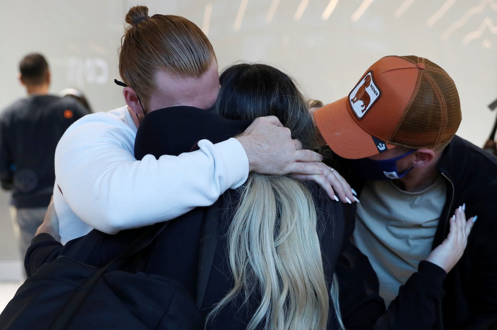 People meeting family members from the U.S. embrace at the international arrivals area of Terminal 5 in London's  Heathrow Airport, Britain, Aug. 2, 2021. (Reuters Photo)
