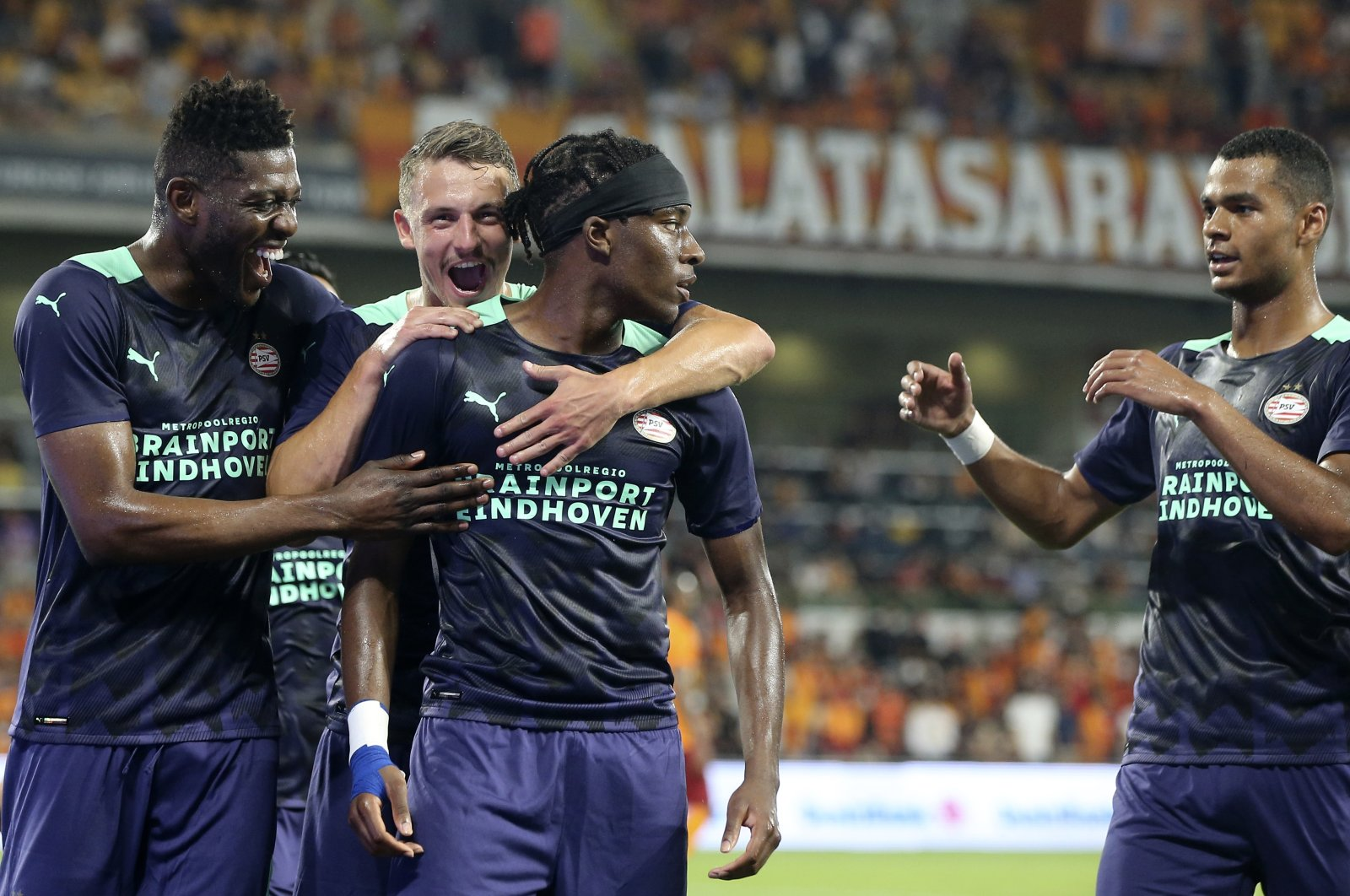 PSV's Noni Madueke (C) is congratulated by his teammates after scoring the opening goal during the Champions League second qualifying round, second leg match against Galatasaray in Istanbul, Turkey, July 28, 2021. (AP Photo)