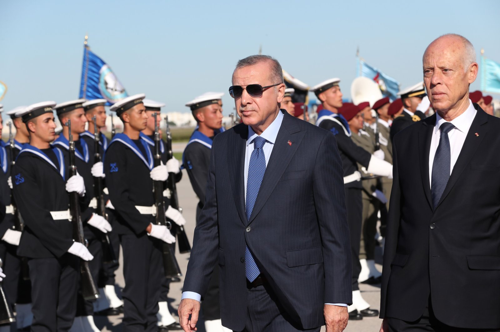 Turkish President Recep Tayyip Erdoğan (C) and his Tunisian counterpart Kais Saied (R) reviewing an honor guard during a welcoming ceremony at the airport in Tunis, Tunisia, on Dec. 25, 2019. (Photo courtesy of the Turkish Presidential Press Service/AFP)