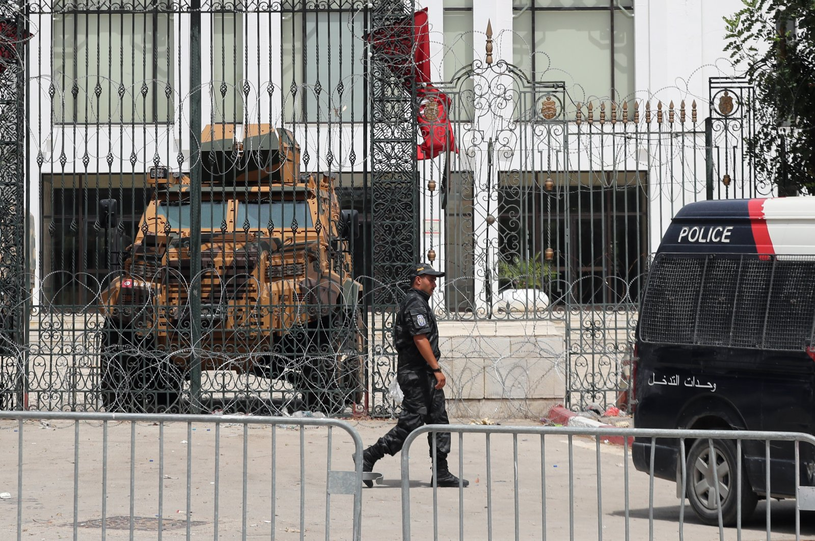 Police cars and a military armored personnel carrier block a side entrance of the Tunisian parliament in Tunis, Tunisia, 01 August 2021. (EPA Photo)