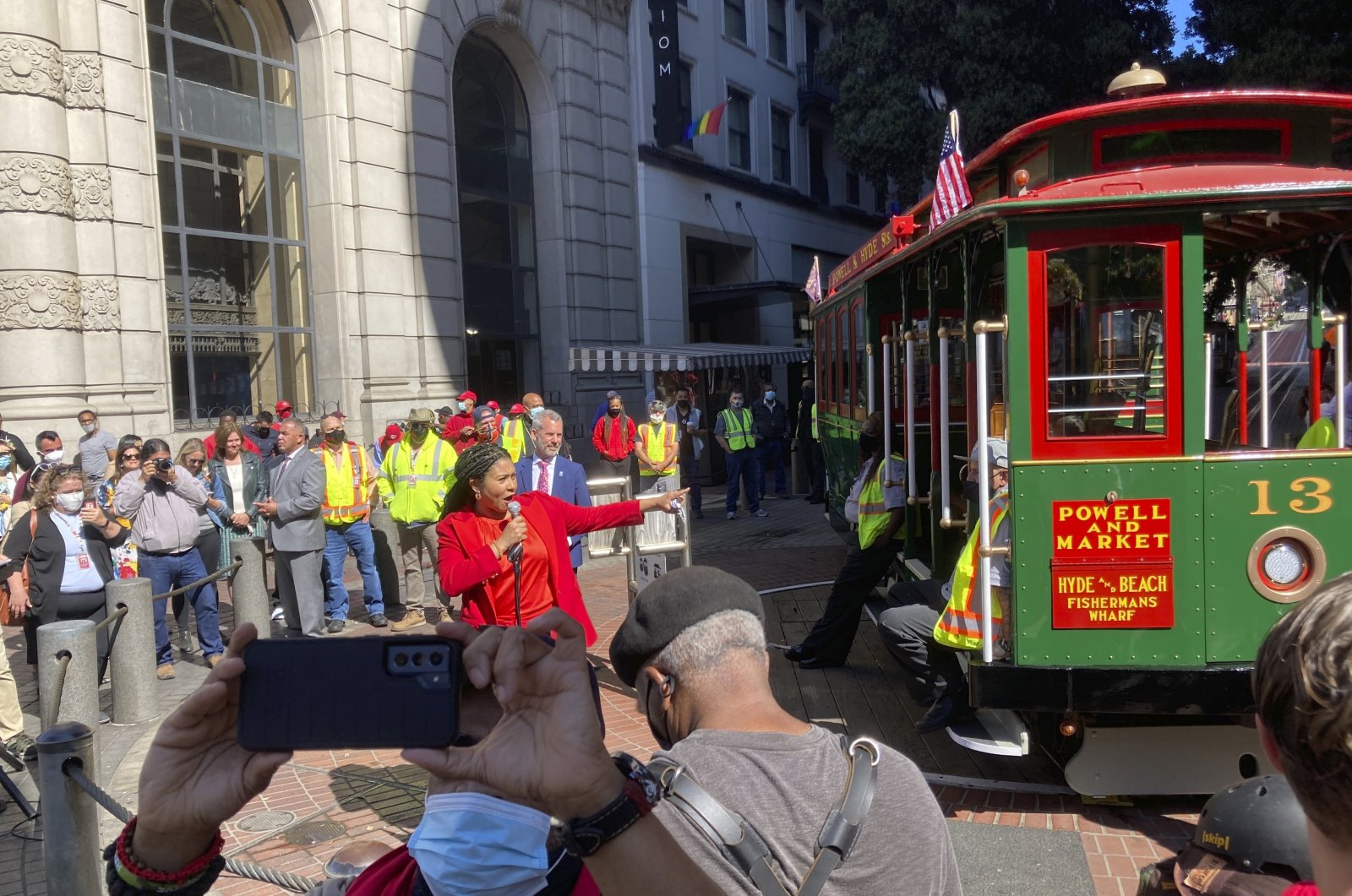 Mayor London Breed welcomes people to the city's cable car service's return during a ceremony at the Powell Street turnaround plaza in San Francisco, U.S., Monday, Aug. 2, 2021. (AP Photo)