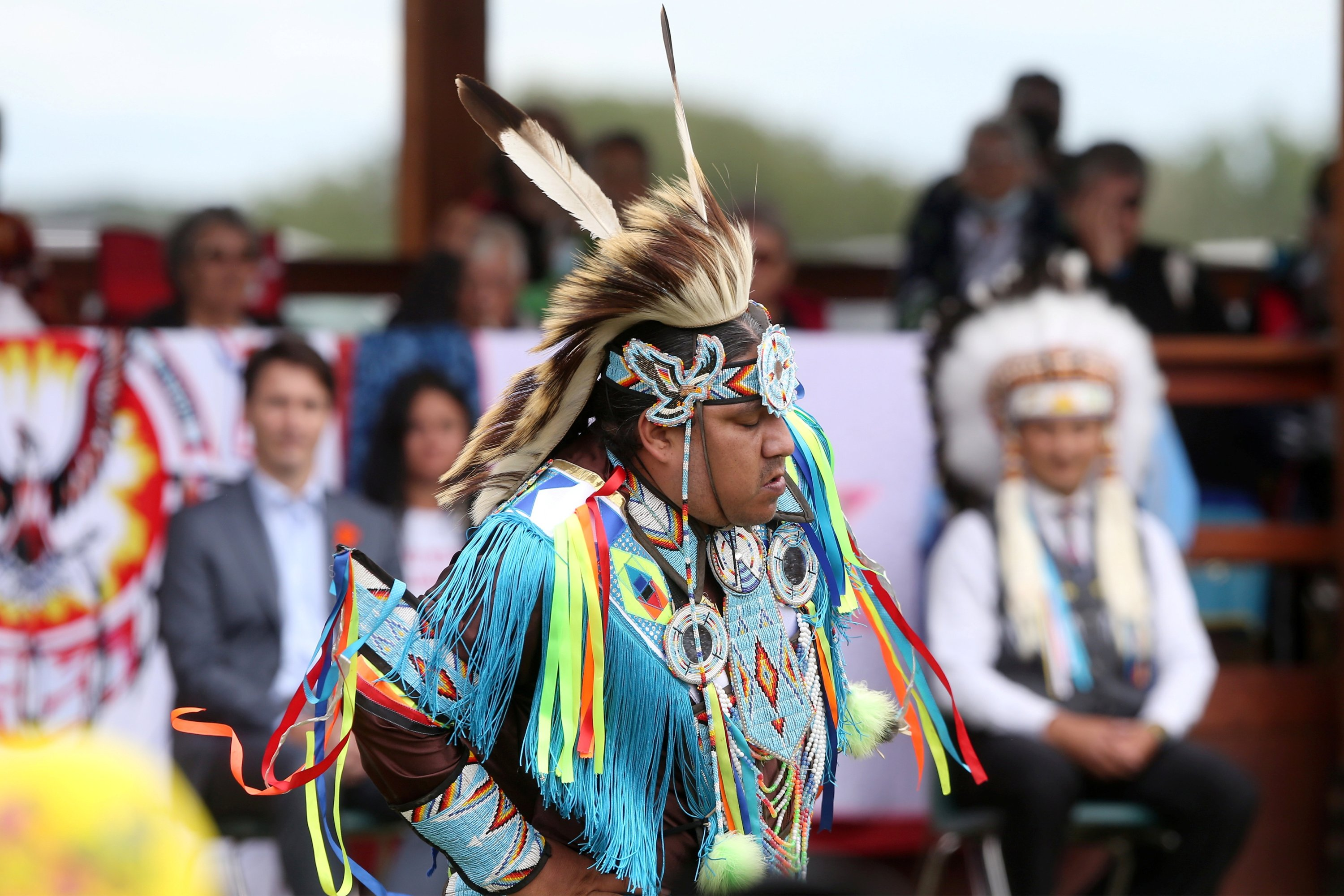A dancer performs for Canada's Prime Minister Justin Trudeau and other dignitaries in the Cowessess First Nation, where a search had found 751 unmarked graves from the former Marieval Indian Residential School near Grayson, Saskatchewan, Canada, July 6, 2021. (REUTERS Photo)