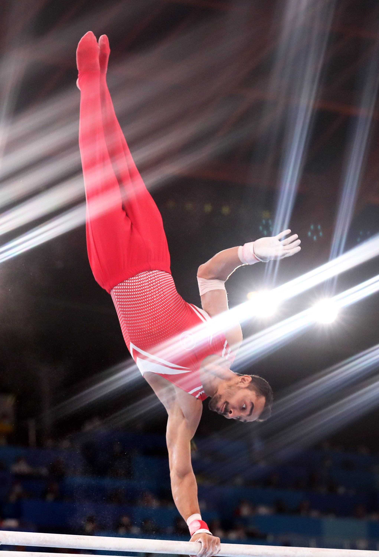 Turkey's Ferhat Arıcan performs in men's parallel bars final at the Tokyo 2020 Olympics, Ariake Gymnastics Centre, Tokyo, Japan, Aug. 3, 2021. (EPA Photo)