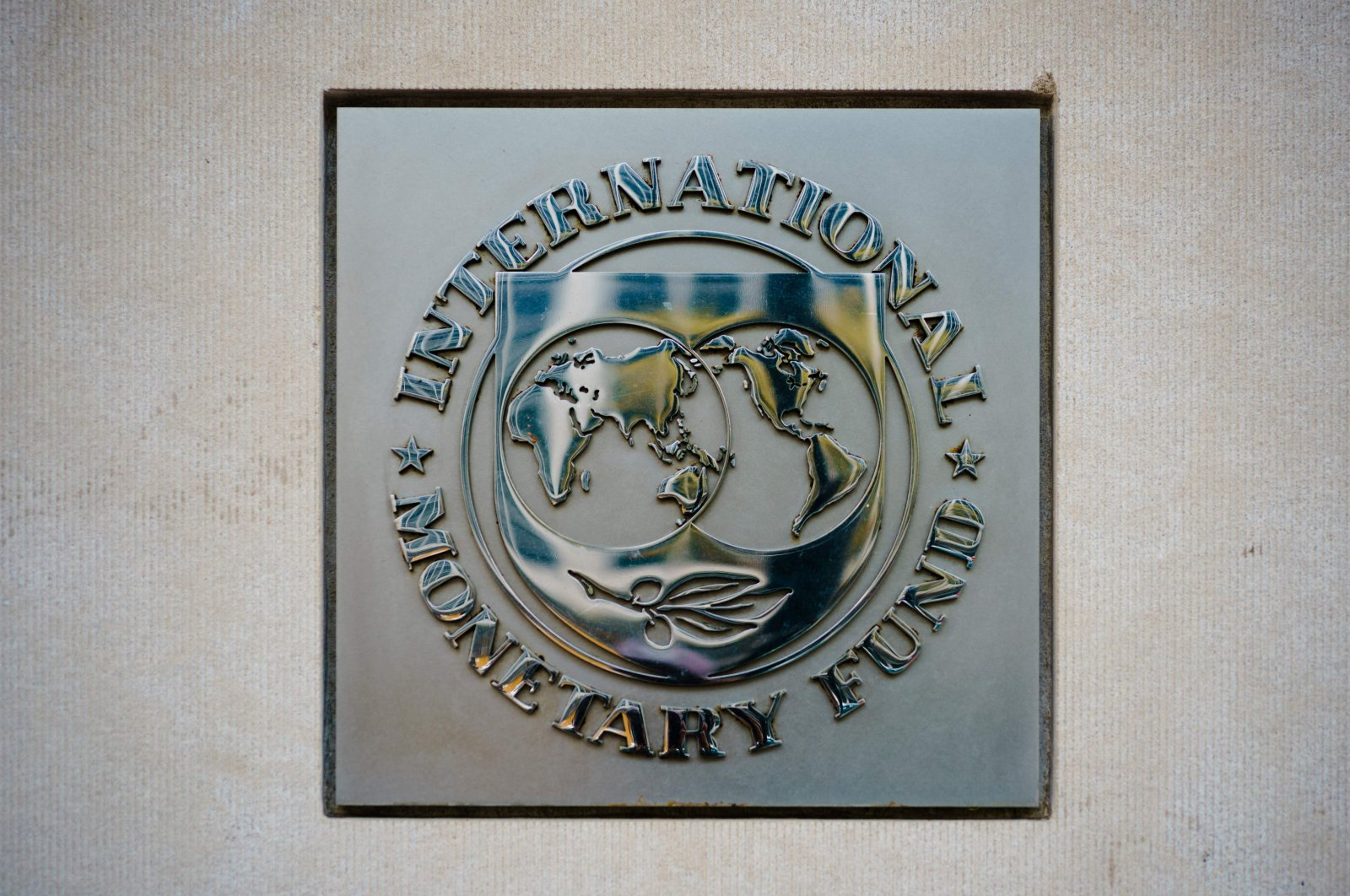 The seal of the International Monetary Fund (IMF) is seen outside of a headquarters building in Washington, D.C., U.S., April 7, 2021. (AFP Photo)