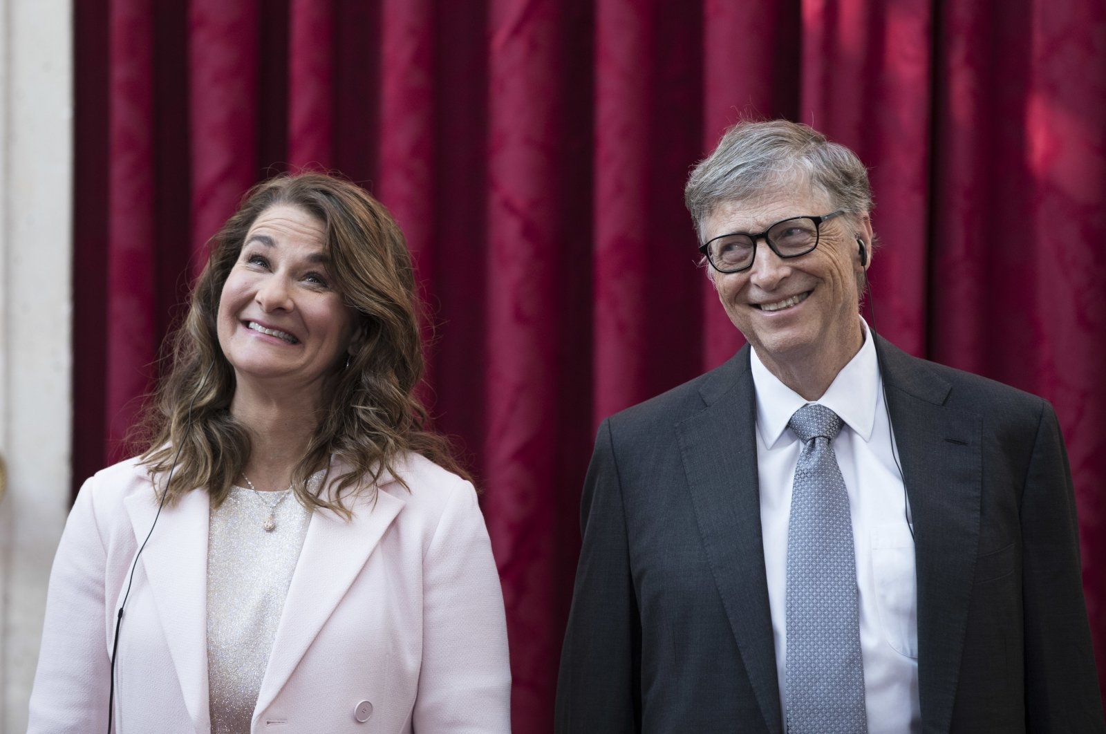 In this April 21, 2017, file photo, philanthropist and co-founder of Microsoft, Bill Gates (R), and his now ex-wife Melinda react, prior to being awarded the Legion of Honour at the Elysee Palace in Paris.   (AP Photo)