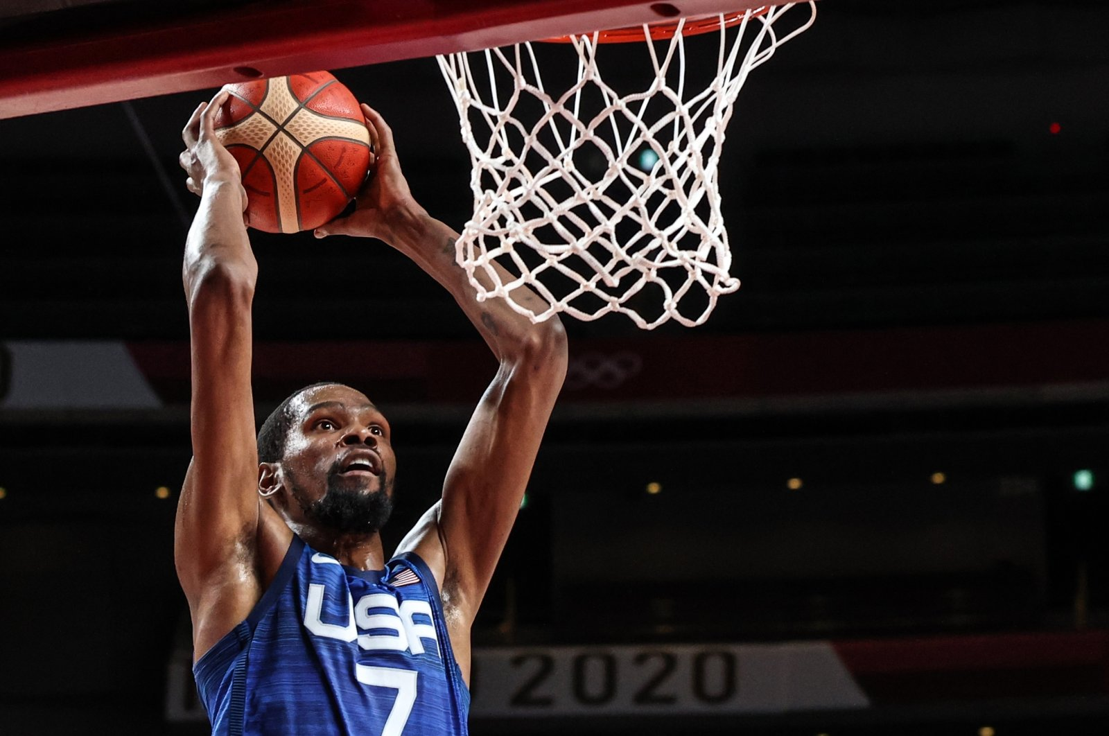 USA's Kevin Wayne Durant (L) goes for the basket in the men's quarterfinal match against Spain during the Tokyo 2020 Olympic Games at the Saitama Super Arena, Saitama, Japan, Aug. 3, 2021.  (AA Photo)