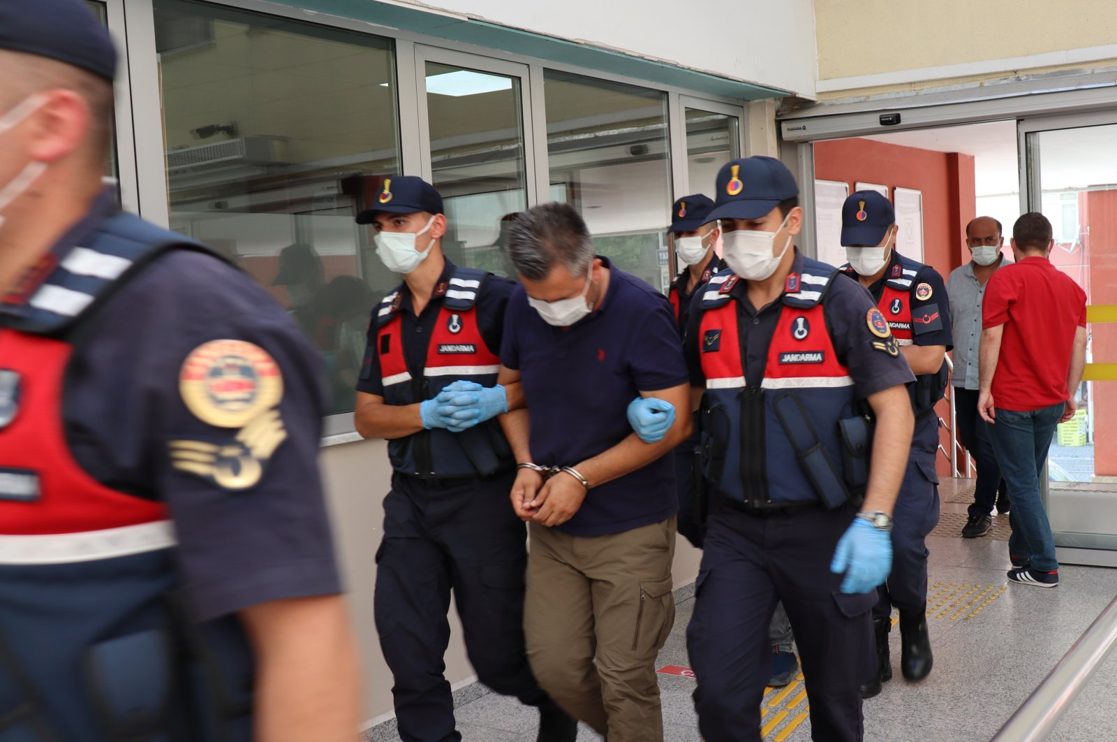 Military officers escort FETÖ suspects, captured in an operation, to the courthouse, in Kocaeli, northwestern Turkey, July 30, 2021. (IHA PHOTO)
