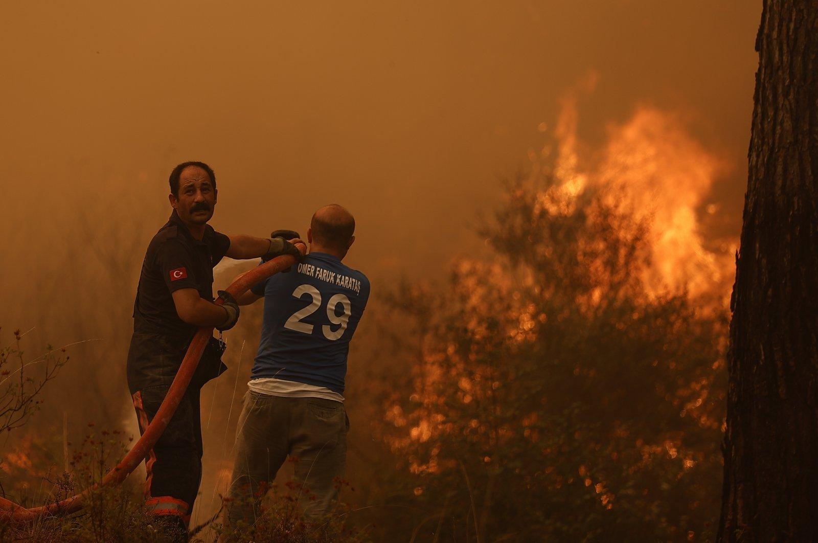 Firefighters battle flames in Manavgat, Antalya, southern Turkey, Aug. 3, 2021. (AA PHOTO)