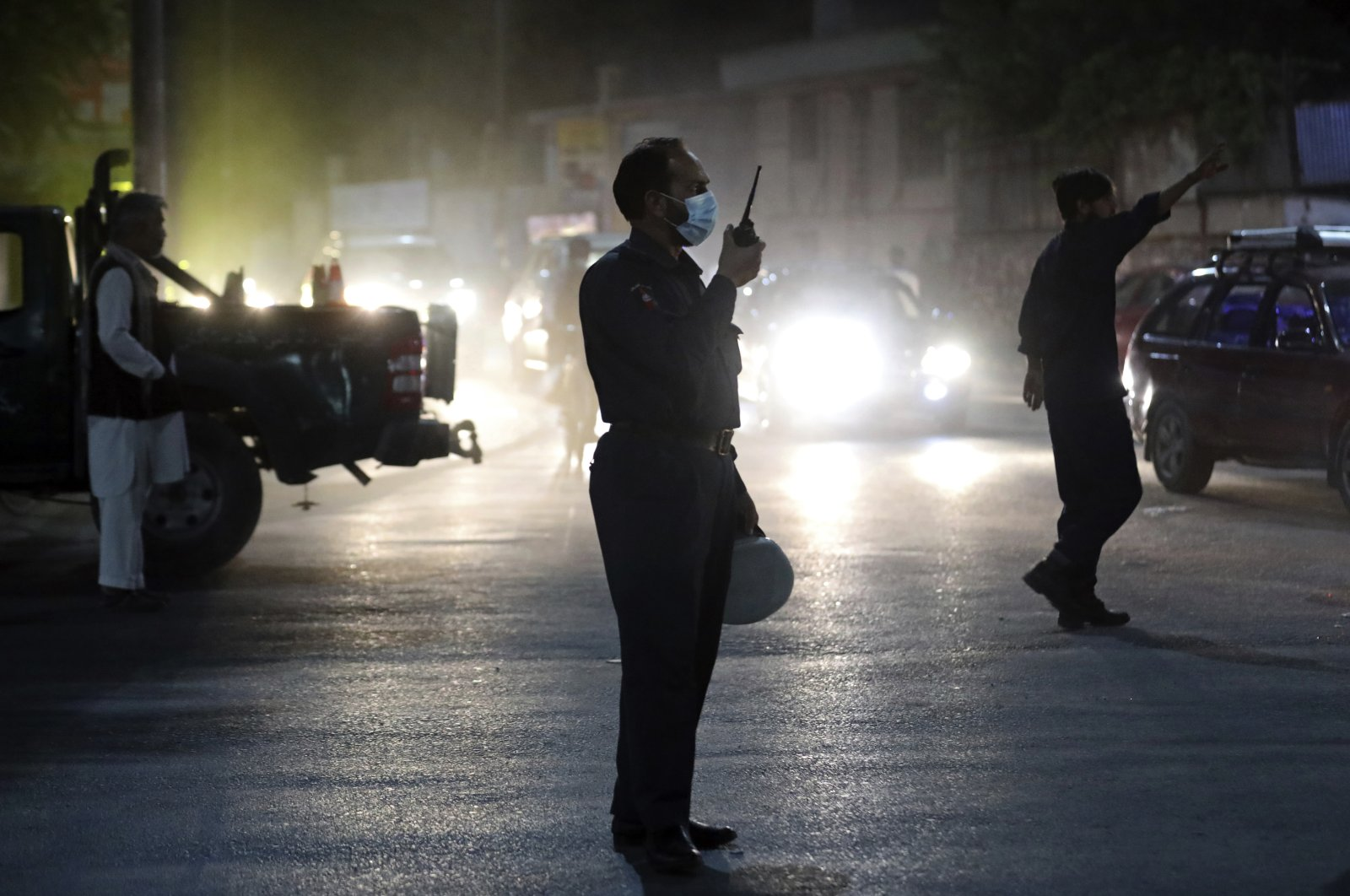 Afghan security personnel work at the site of a powerful explosion in Kabul, Afghanistan, Aug. 3, 2021. (AP Photo)