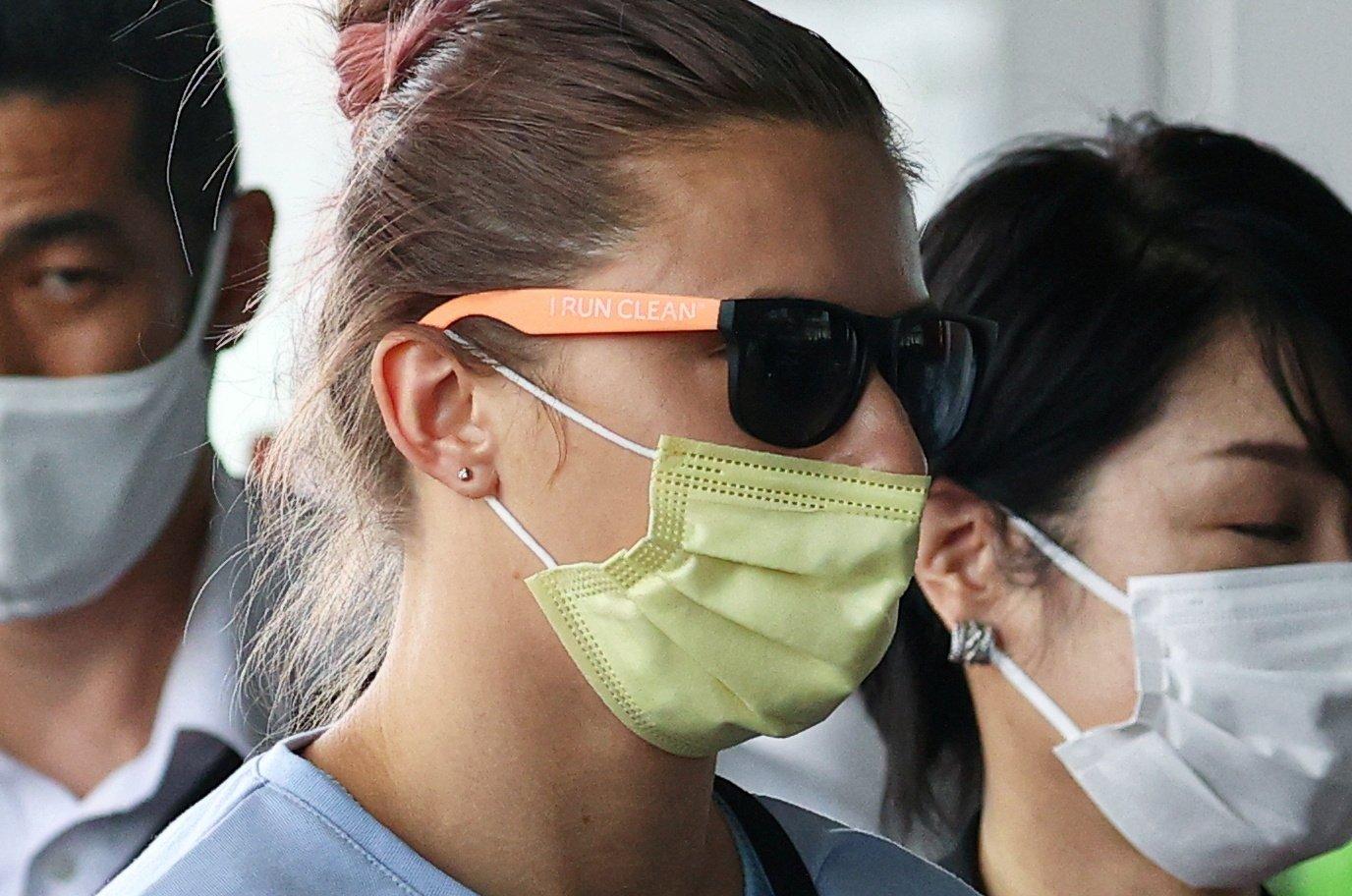 Belarusian Sprinter Krystsina Tsimanouskaya, who took refuge in the Polish embassy in Tokyo, arrives at Narita International Airport to leave for Vienna, in Narita, Tokyo, Japan, Aug. 4, 2021. (AFP Photo)