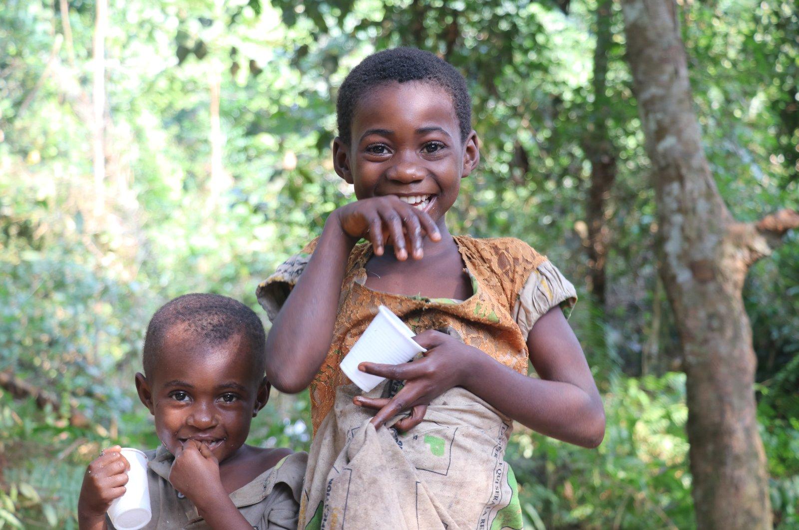 Pygmy children smile in Bikuitsi-Njule, Cameroon, Aug. 2, 2021. (AA Photo)