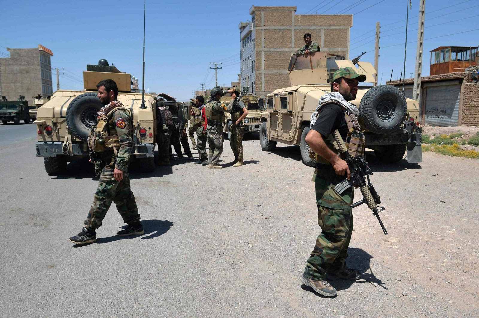 Afghan National Army commando forces walk along a road amid ongoing fighting between Taliban and Afghan security forces in the Enjil district of Herat province, Aug. 1, 2021. (AFP Photo)
