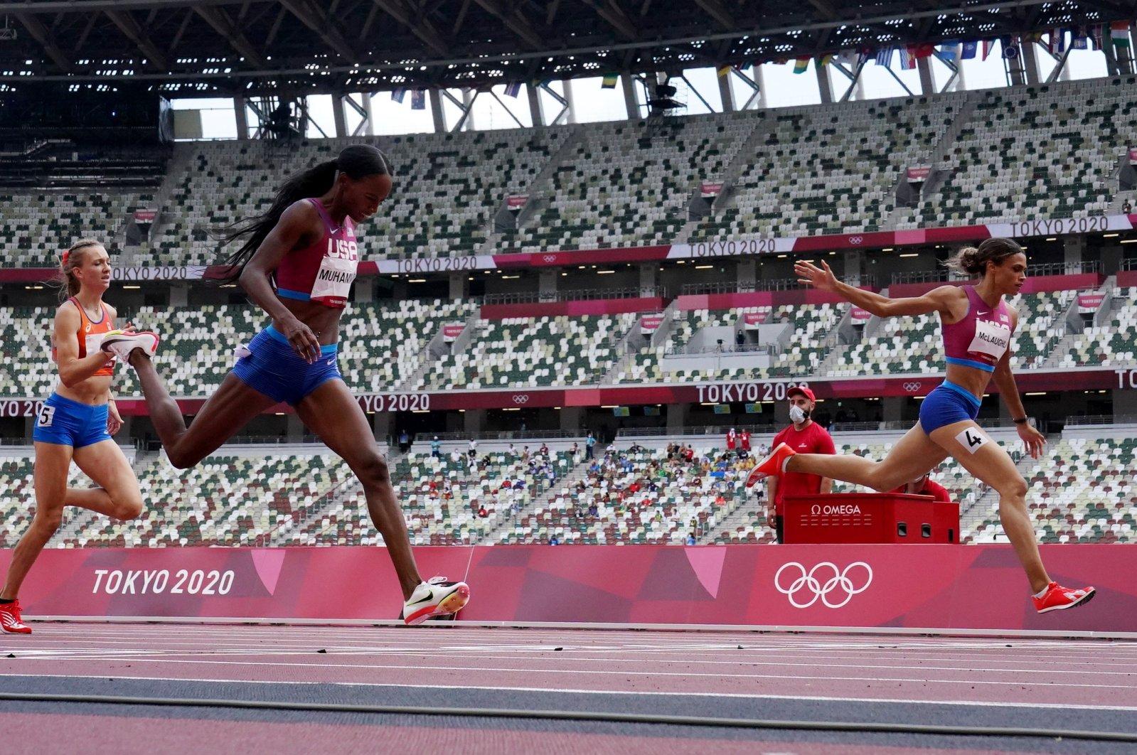 U.S. hurdler Sydney McLaughlin (R) crosses the finish line to win 400-meter hurdles gold at the Tokyo 2020 Olympics, Olympic Stadium, Tokyo, Japan, Aug. 4, 2021. (Reuters Photo)