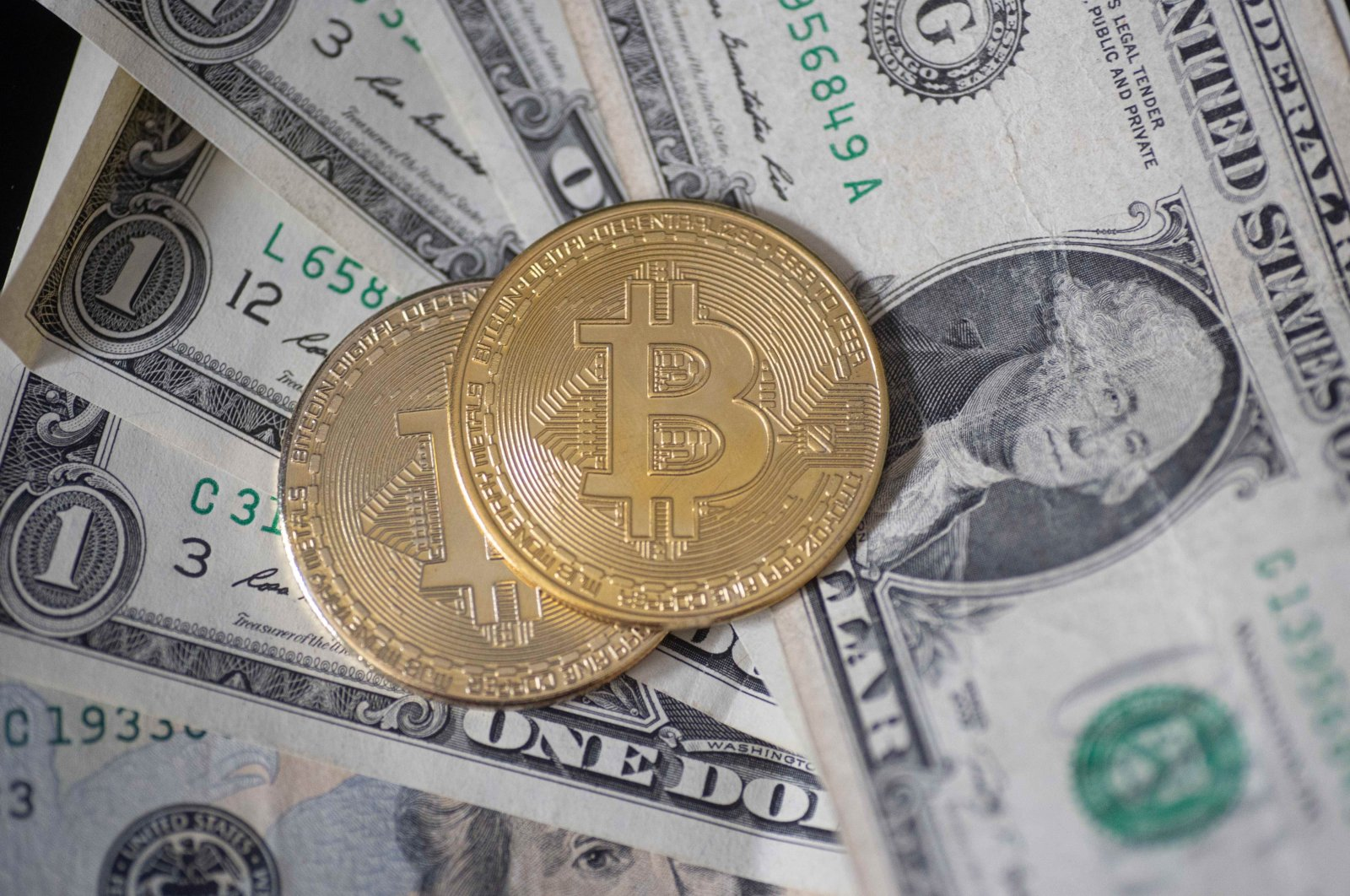 Visual representations of the digital cryptocurrency Bitcoin with the U.S. dollar bill, Thessaloniki, Greece, July 23, 2021. (Photo by Getty Images)