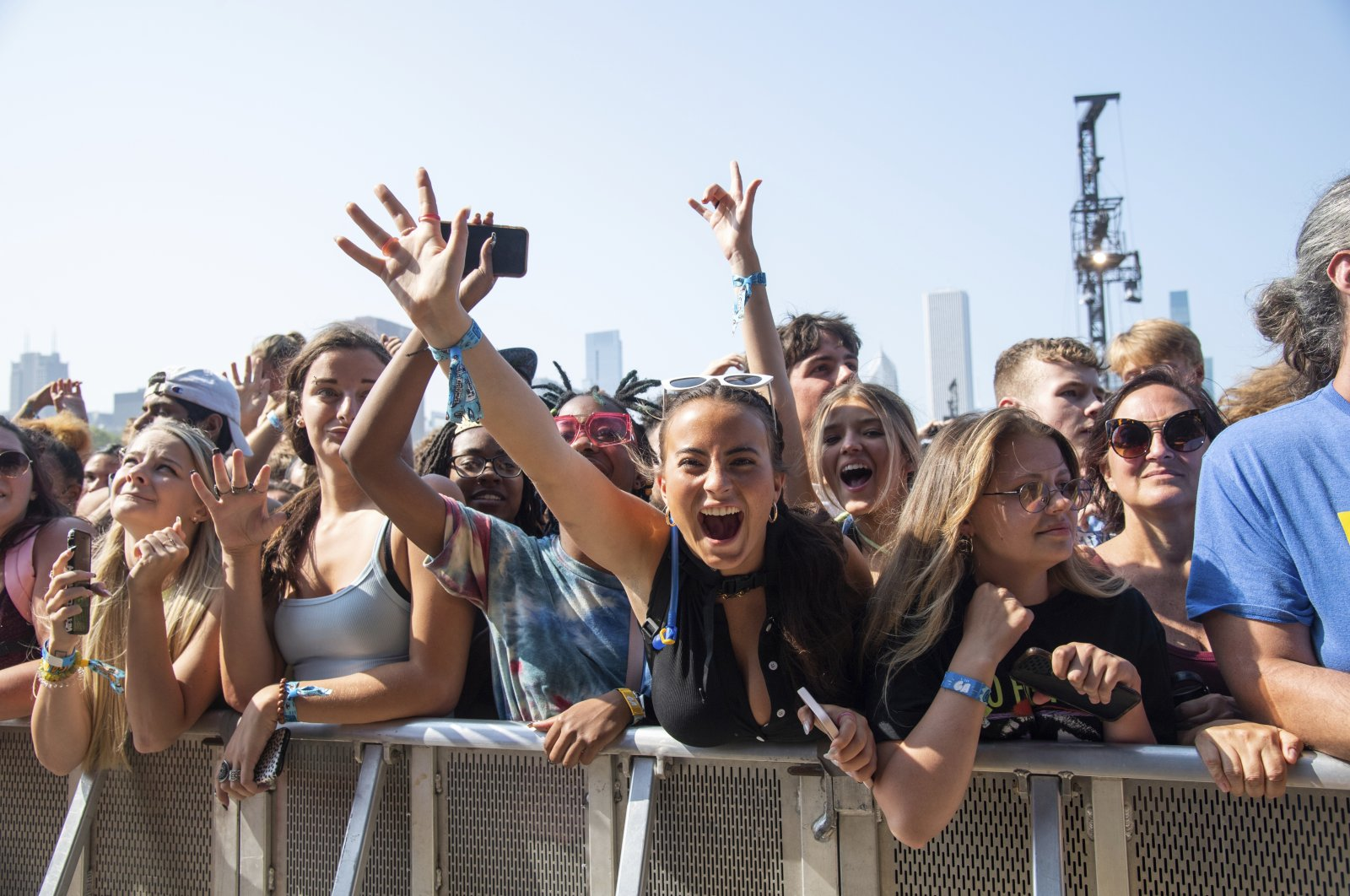 Festival goers seen on day four of the Lollapalooza Music Festival, Sunday, Aug. 1, 2021, at Grant Park in Chicago. (AP Photo)