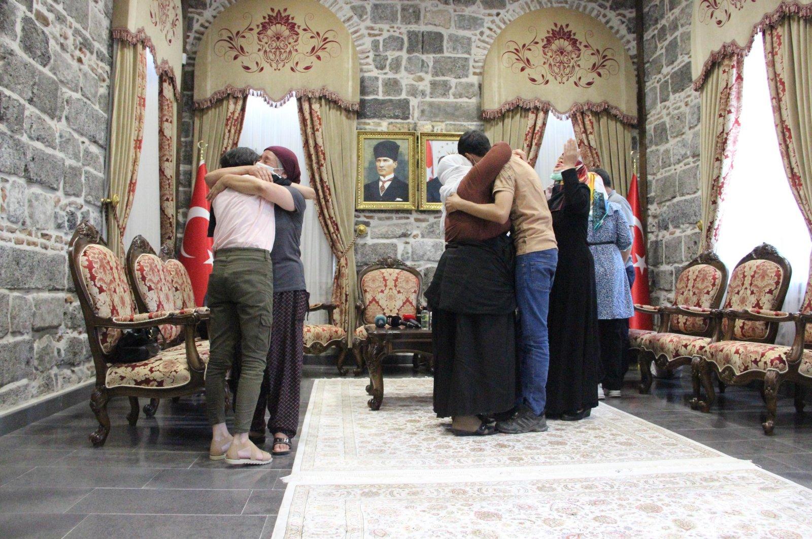 Families of former PKK terrorists Mustafa Biçer, EnsariKaraşanandAlevTuran reunite with their children in Diyarbakir, Turkey, July 29, 2021. (DHA Photo)