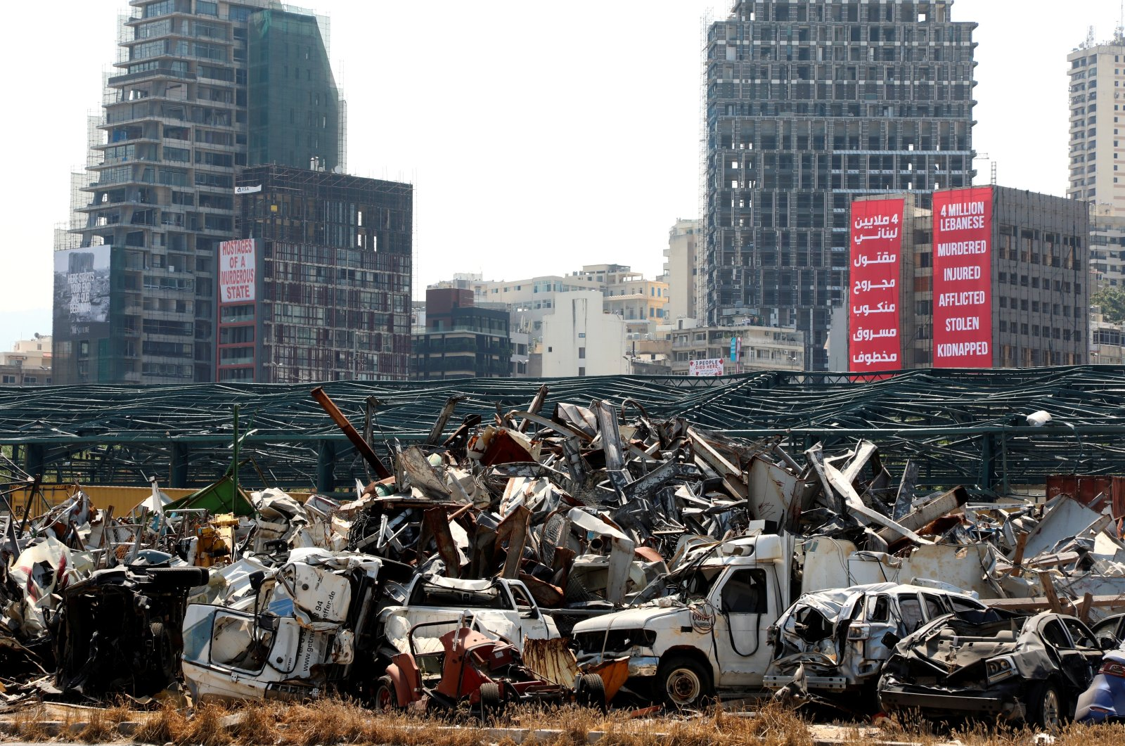 Damaged cars from last year's Beirut port blast as Lebanon marks the one-year anniversary of the explosion, Beirut, Lebanon Aug. 4, 2021. (Reuters Photo)